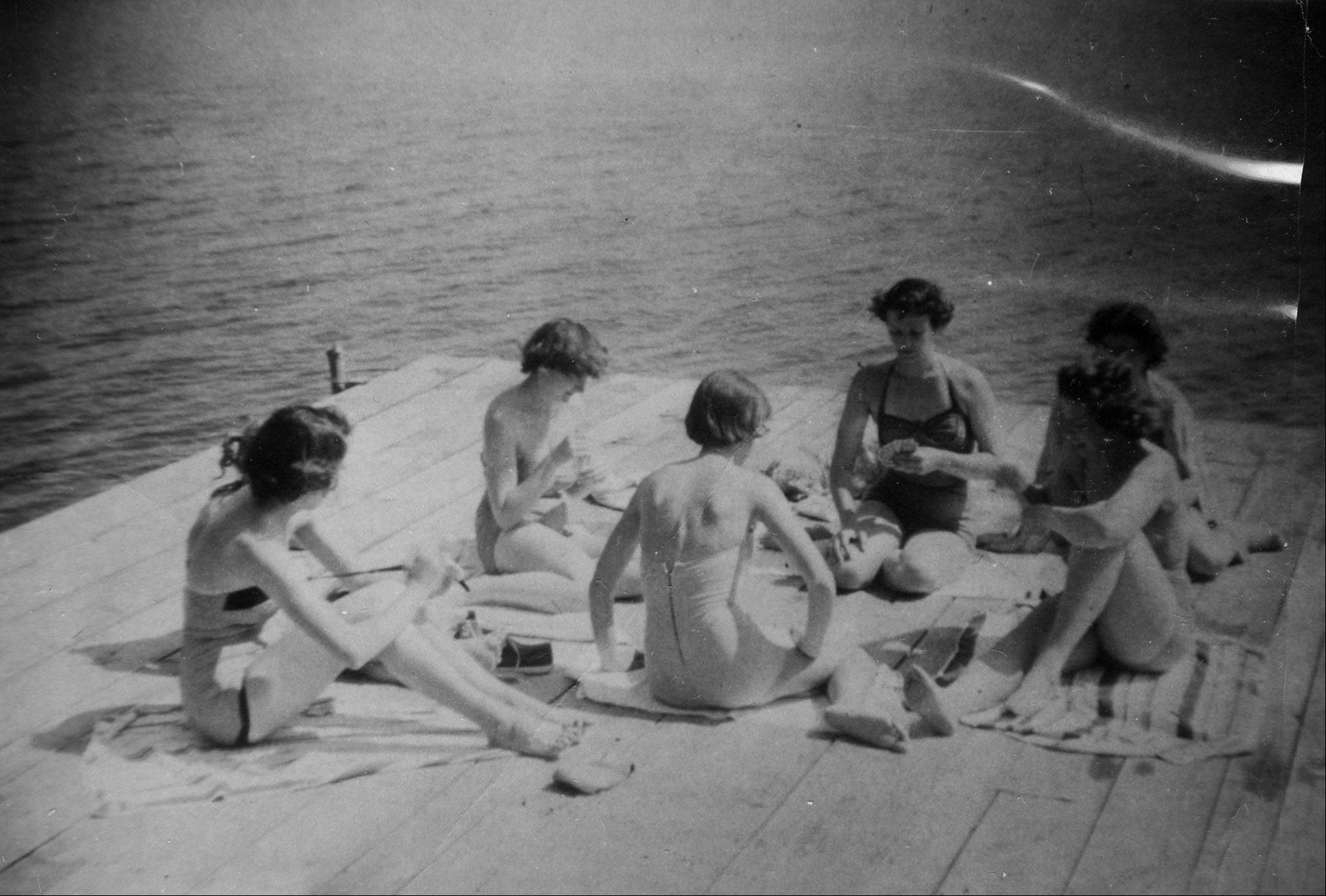 Moody�s Camp owner Lucile Seitz, third from right, enjoys a rare game of cards with several guests on the resort�s popular swim dock in 1957.