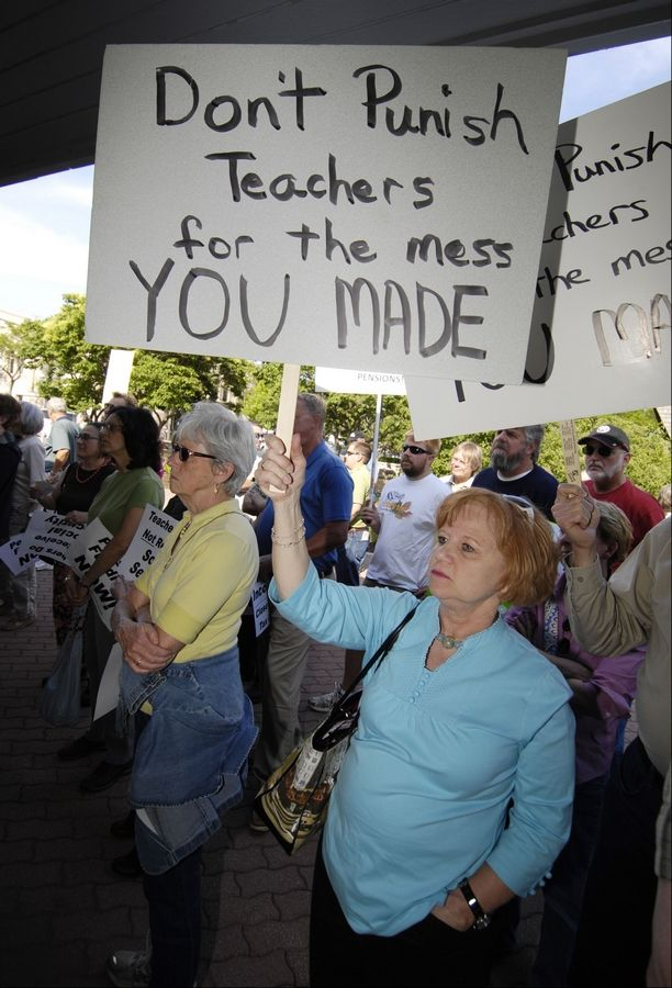 Patty Dixon of Lisle, a teacher at South Middle School in Arlington Heights, protests proposed pension cuts during a rally in April in Naperville.