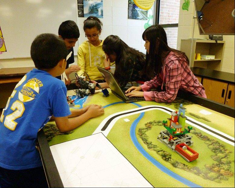 "Sixth-grade students at Hoover Math and Science Academy in Schaumburg participated in the ""Green City Robotics Challenge"" with a $10,000 robotics grant from Lego. Schaumburg High School students and Motorola engineers assisted them."