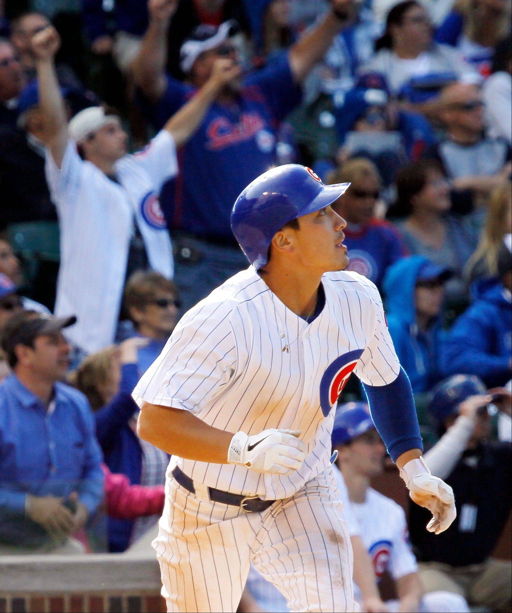 The Cubs' Darwin Barney watches his walk-off, 2-run home run off Padres relief pitcher Dale Thayer in the ninth inning Wednesday at Wrigley Field.