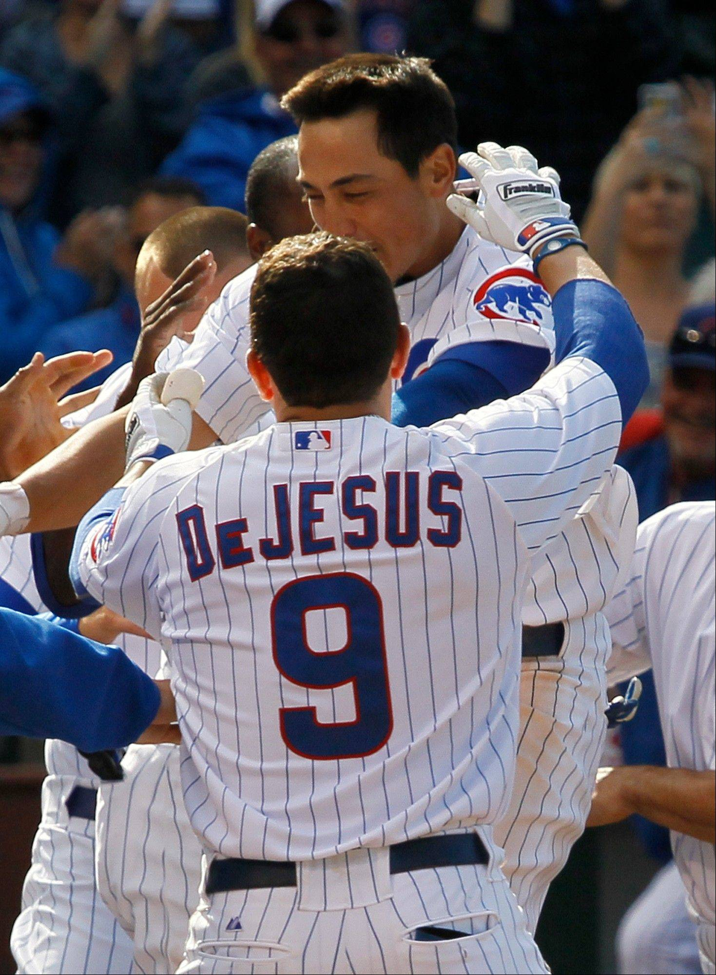 The Cubs' Darwin Barney, right, celebrates with teammates after hitting the game-winning, 2-run homer in the ninth inning Wednesday at Wrigley Field.