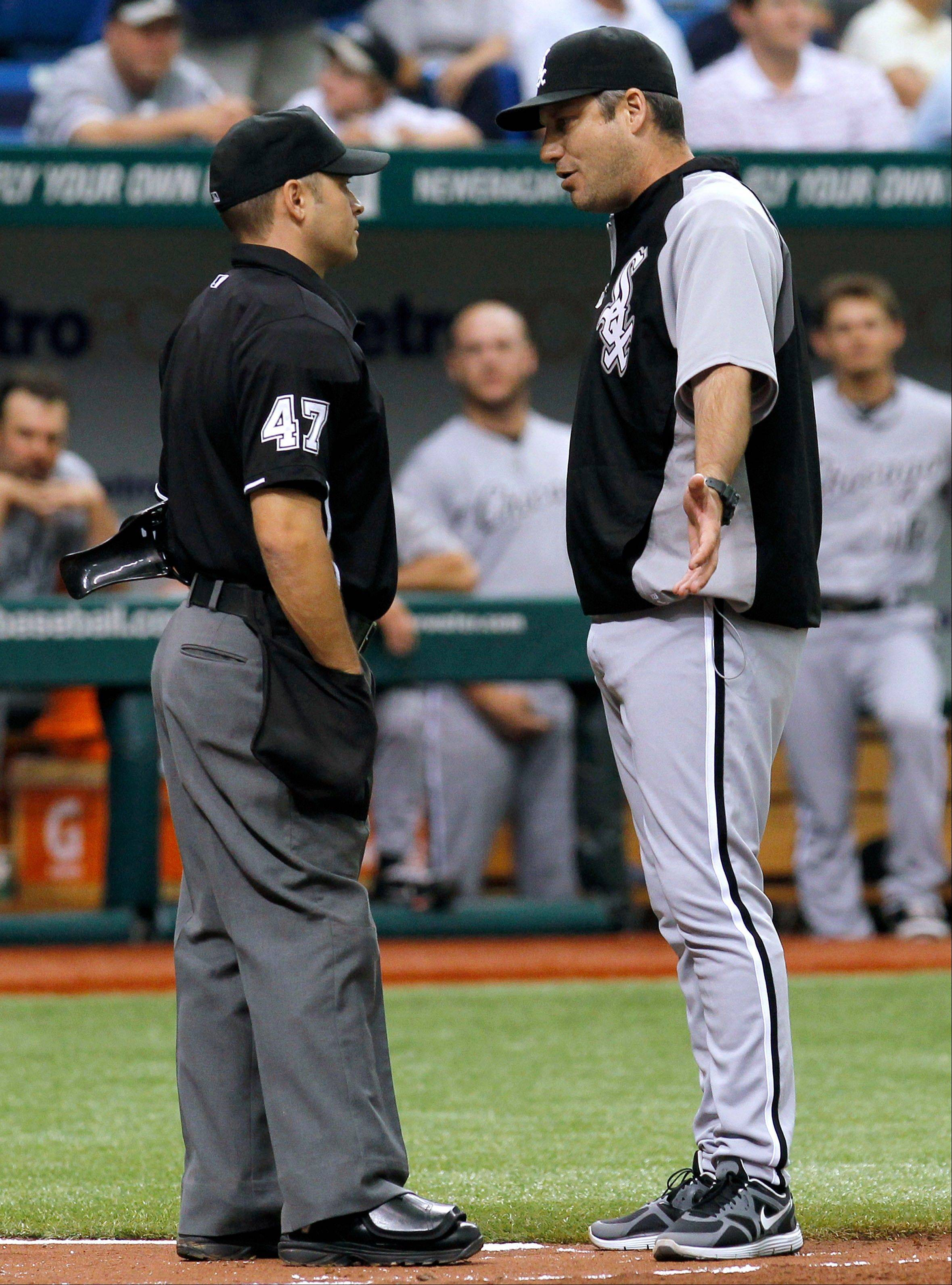 White Sox manager Robin Ventura argues with home plate umpire Mark Wegner after White Sox pitcher Jose Quintana was ejected for throwing behind Tampa Bay Rays' Ben Zobrist Wednesday during the fourth inning in St. Petersburg, Fla. Ventura was also ejected.