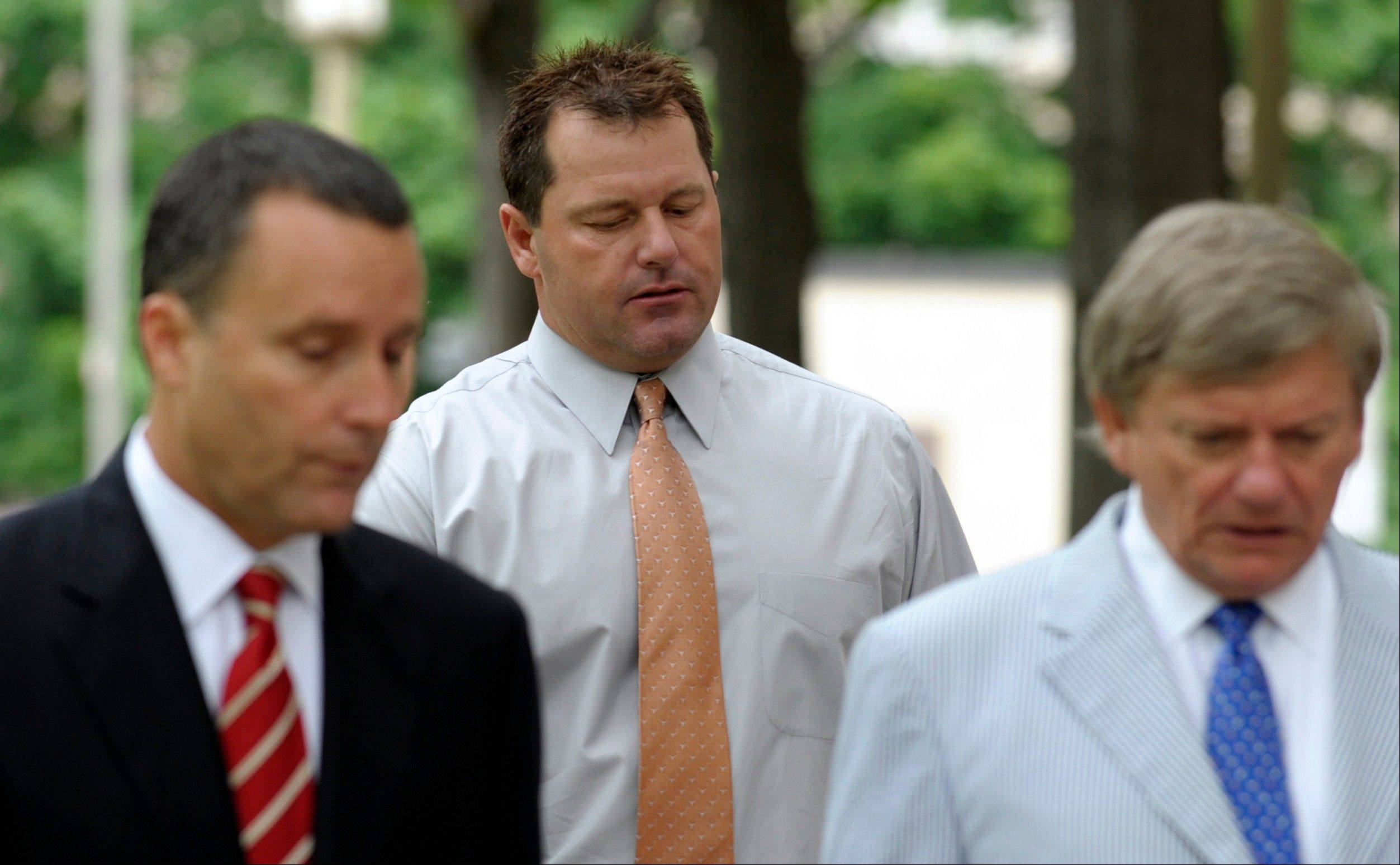Former Major League baseball pitcher Roger Clemens, center, and his legal team, arrive Wednesday at federal court in Washington. Attorney Rusty Hardin is at right.