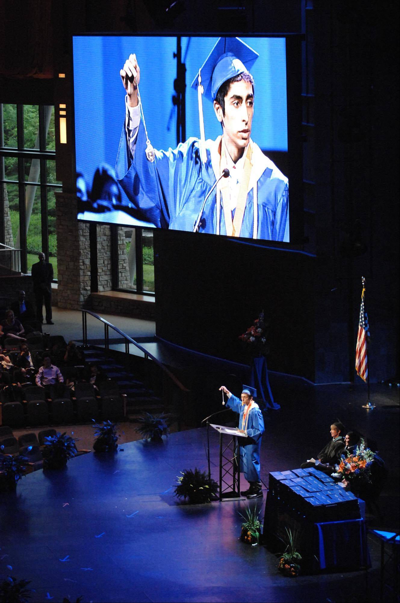 Karim Mohammadali delivers an address at Thursday's Hoffman Estates High School graduation ceremony at Willow Creek Church in South Barrington.