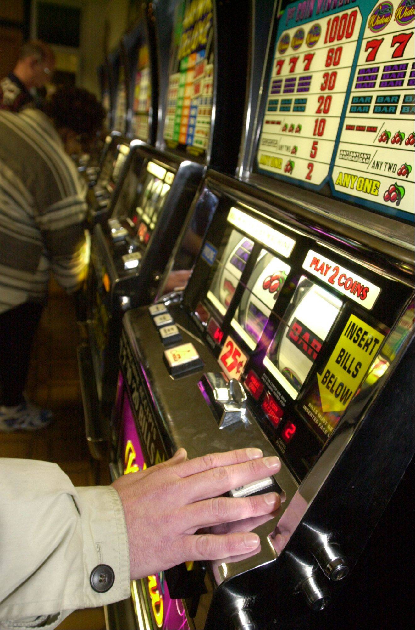 Lawmakers voted on a plan Thursday that would bring slot machines to Arlington Park and add casinos, including ones in Lake County and Chicago.