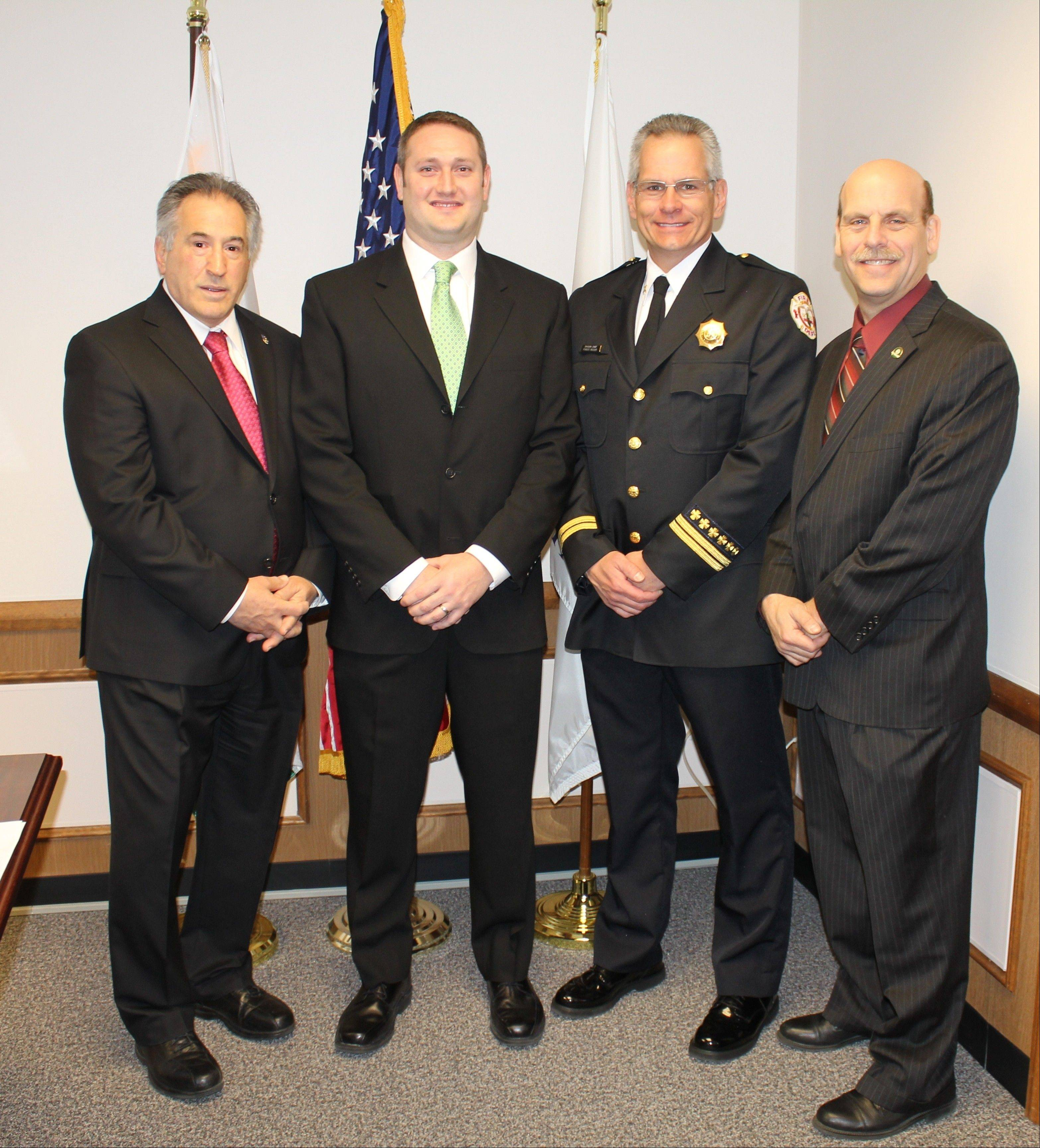Pictured in the mayor's office, from left, following the swearing-in ceremony are: Des Plaines Mayor Martin J. Moylan, newly sworn Firefighter/Paramedic Christopher Jannusch, Training and Safety Officer Forest Reeder and Fire Chief Alan Wax.