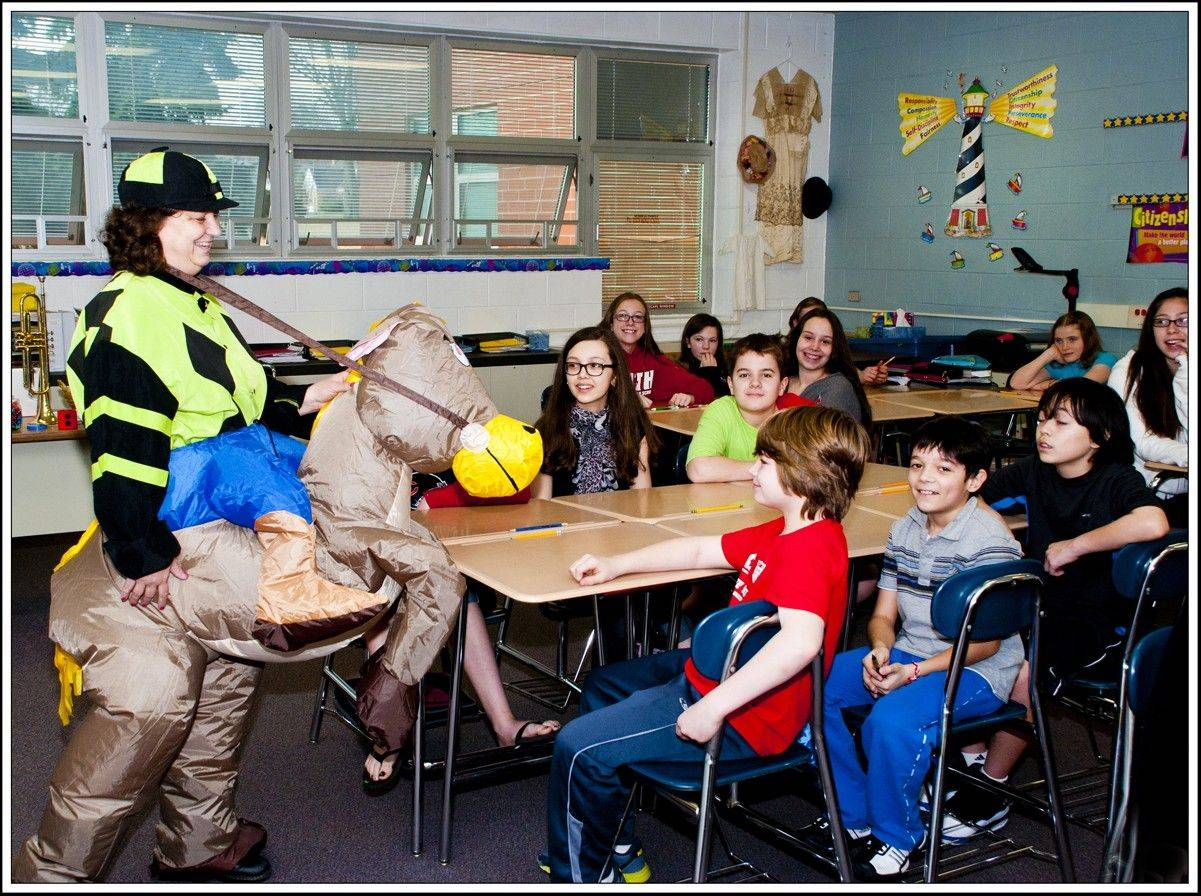 Submitted by Arlington Heights Quasquicentennial CommitteeMary Kay Zimmanck, math teacher at South Middle School, dresses as a jockey to teach her students math.