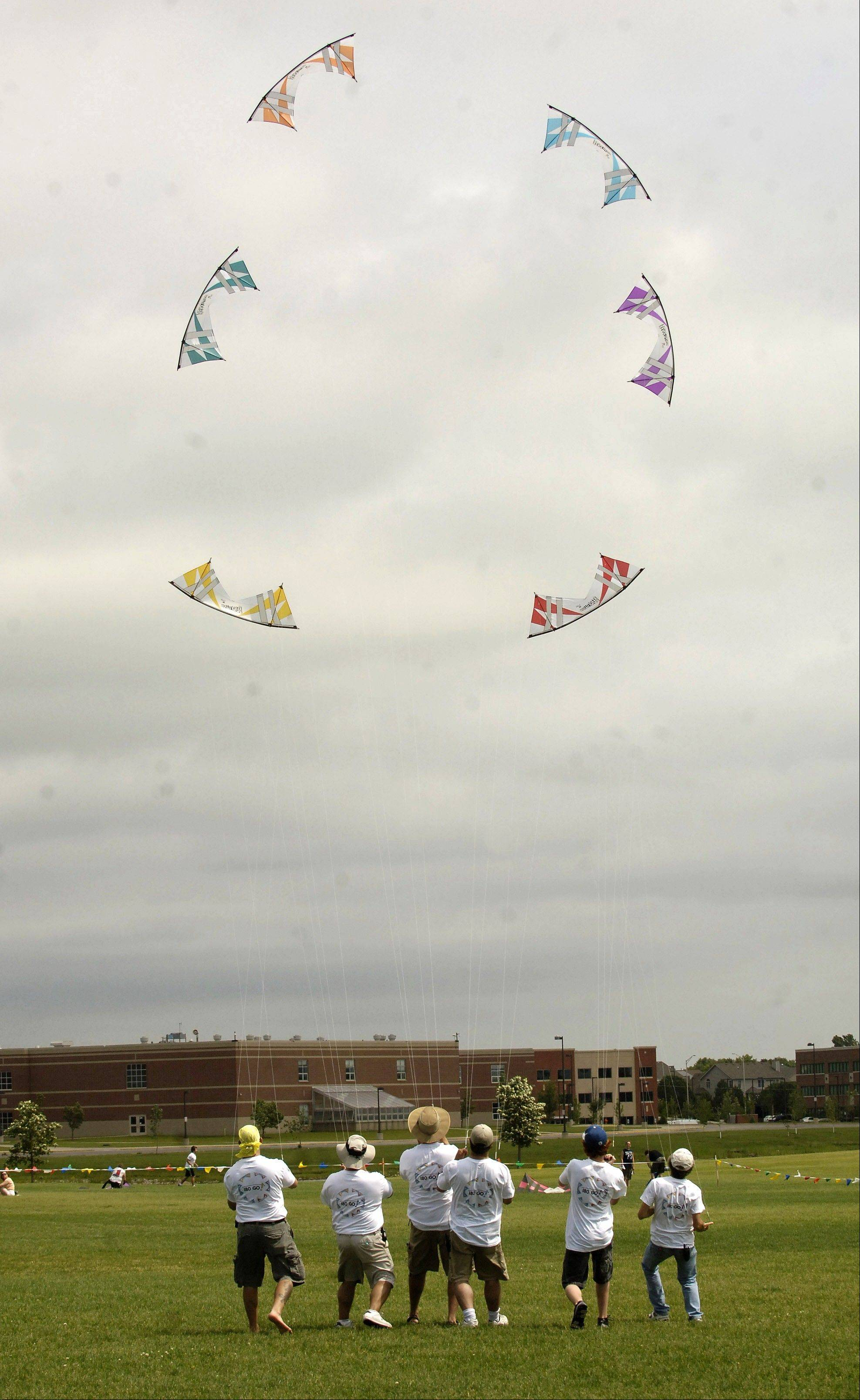 Members of the 180-Go kite team fly their kites to a Santana song during the 2009 Frontier Kite Fly Festival in Naperville.