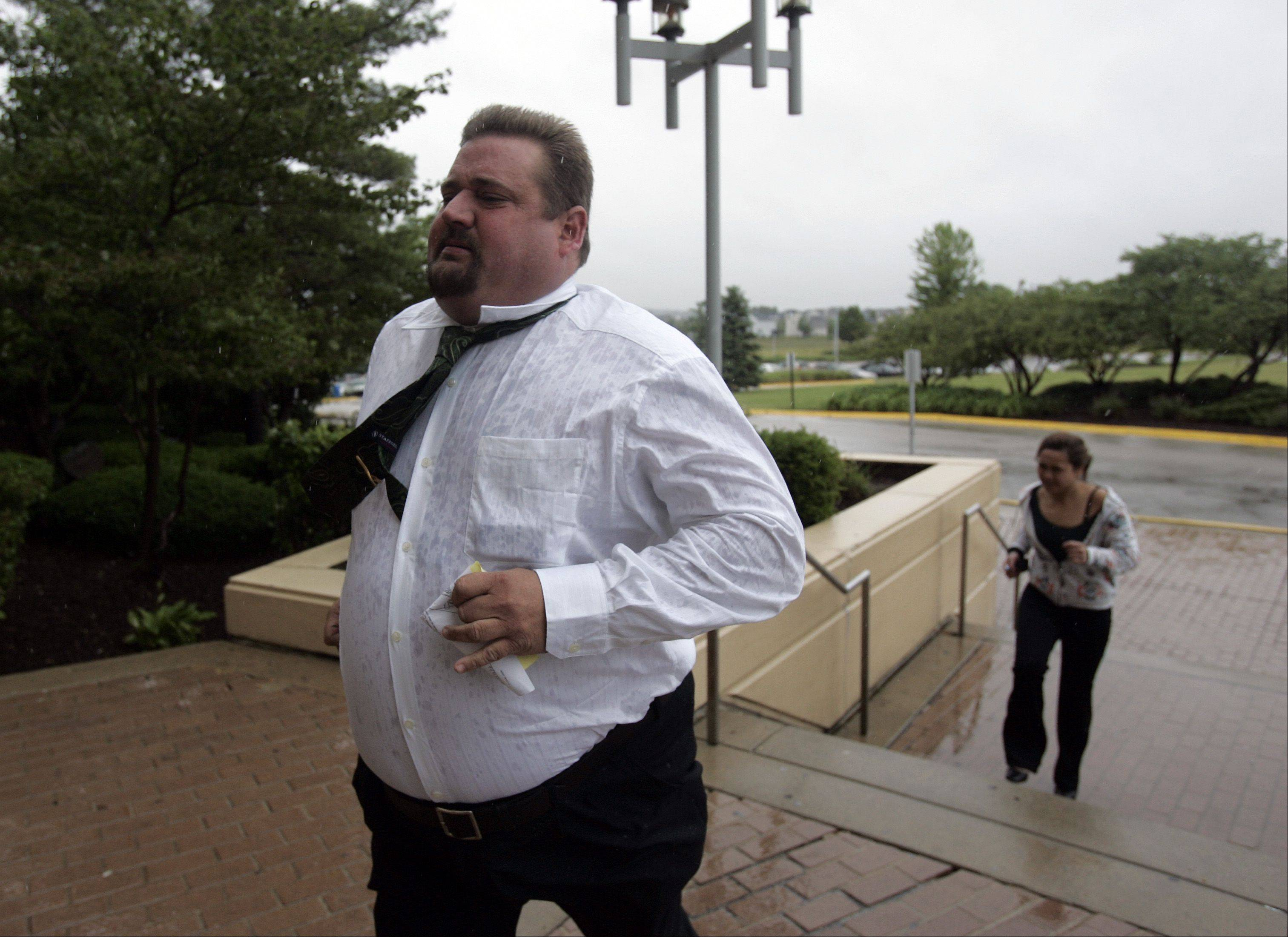 Phillip Rinn, a repeat dog abuser from Aurora, enters the Kane County Judicial Center in St. Charles Thursday for his sentencing for breaking his dog's teeth in late 2010. Rinn, who was convicted of killing one of his dogs in the 1990s, pleaded guilty to felony animal cruelty earlier this year.
