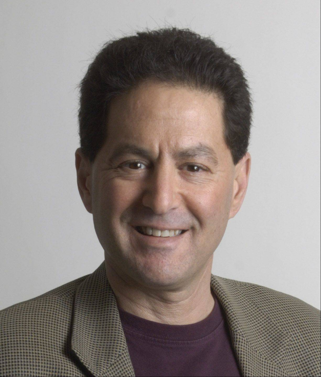 Daily Herald sports columnist Barry Rozner has been named a Distinguished Alumni by Northern Illinois University.