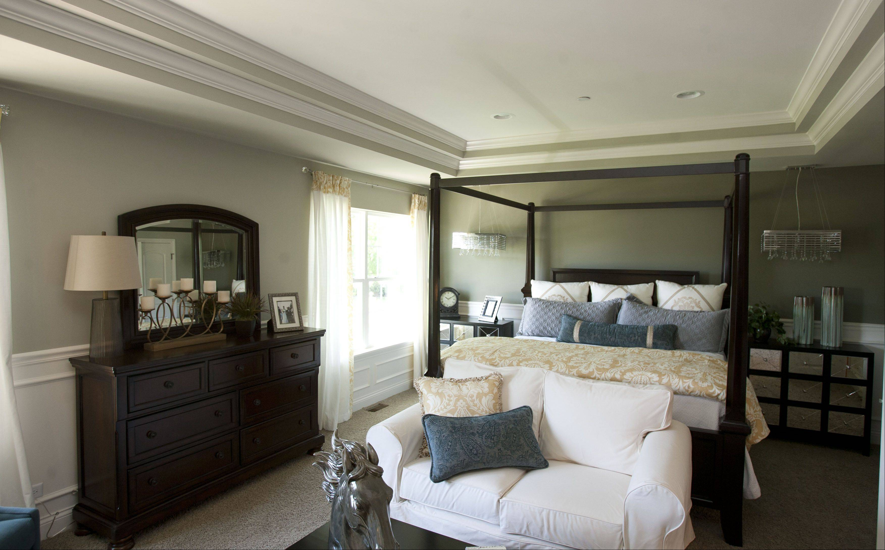Each room in the Morton model, including this master bedroom, was furnished by Mary Ward, director of design for Laura O'Connor Design.