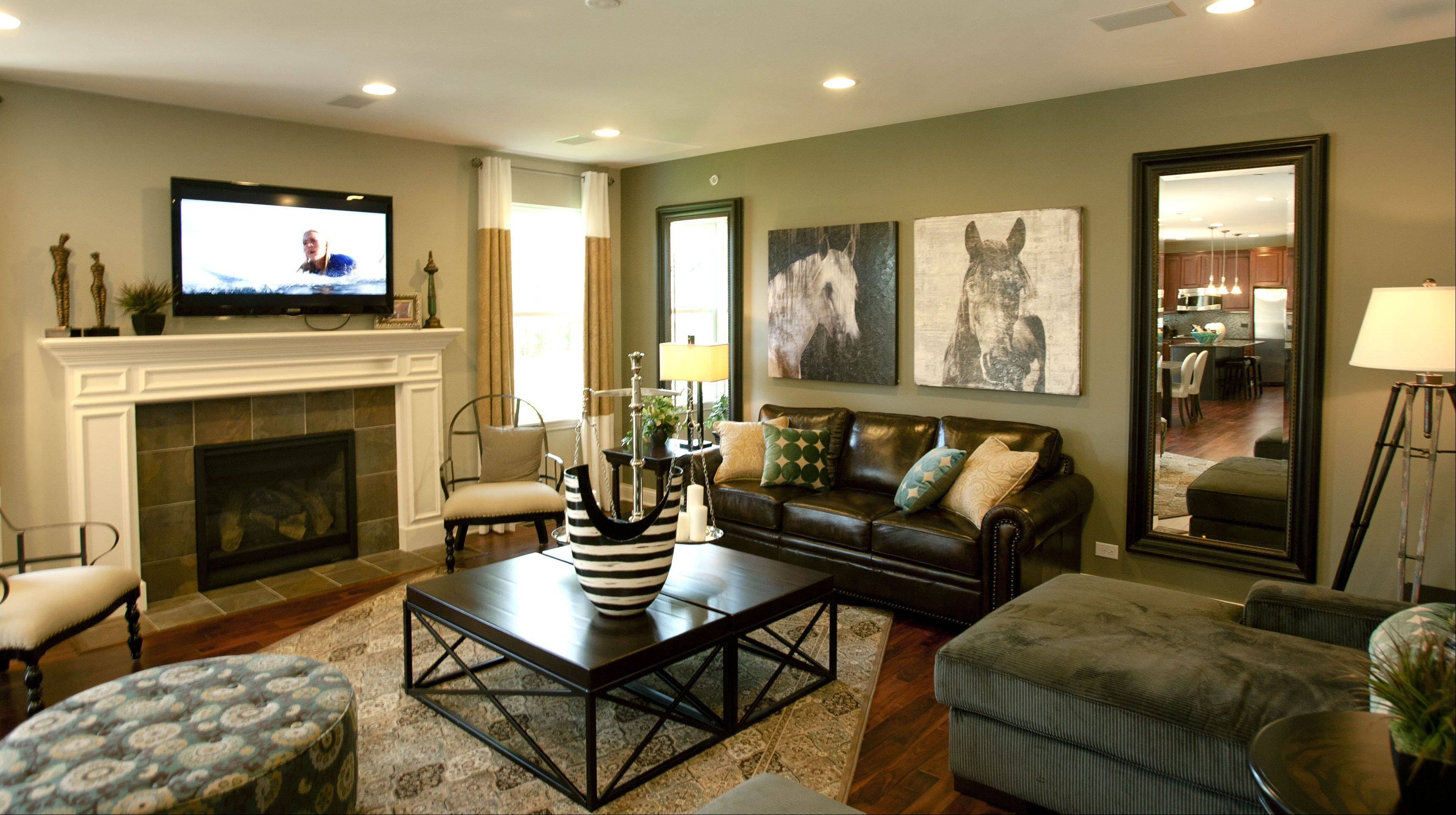 An array of seating in the living room includes a leather sofa with pictures of horses above and mirrors on either side.
