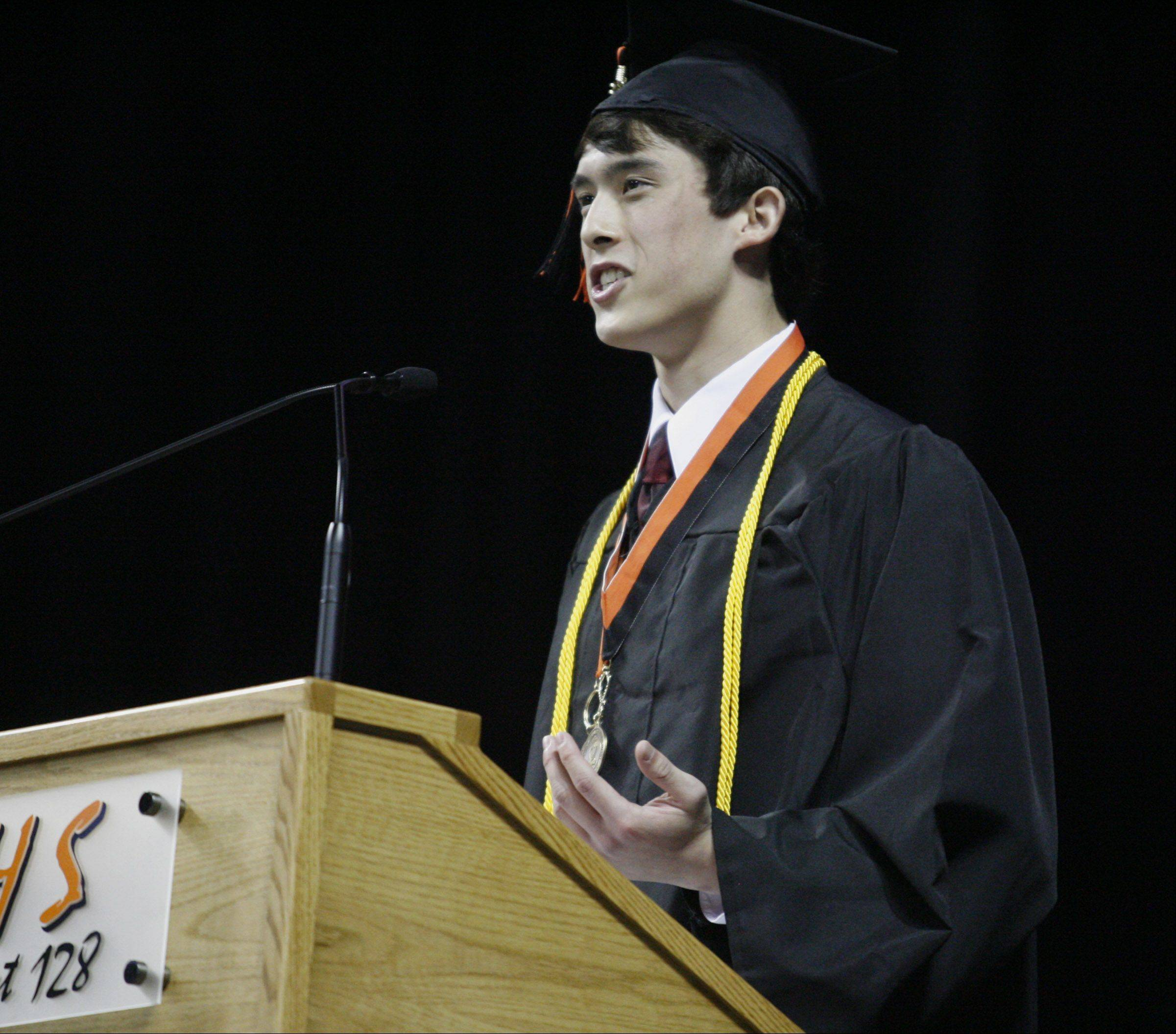 Luke San, class of 2012, speaks to graduates during Libertyville High School's graduation on Friday, June 1 at the Sears Centre in Hoffman Estates.