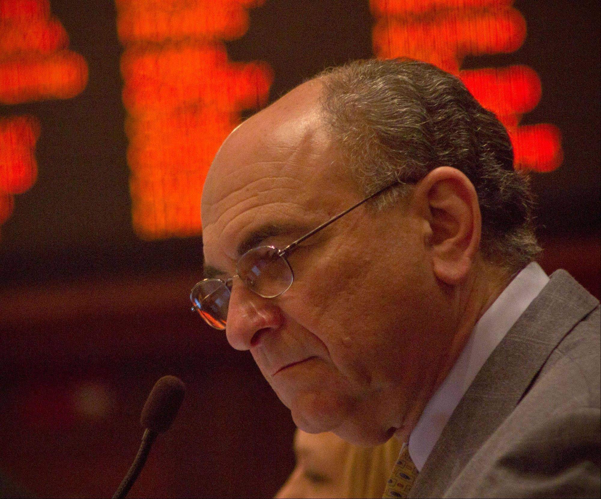 Rep. Lou Lang, a Skokie Democrat, reads a bill Wednesday in the House of representatives. Lang is a longtime supporter of gambling expansion.