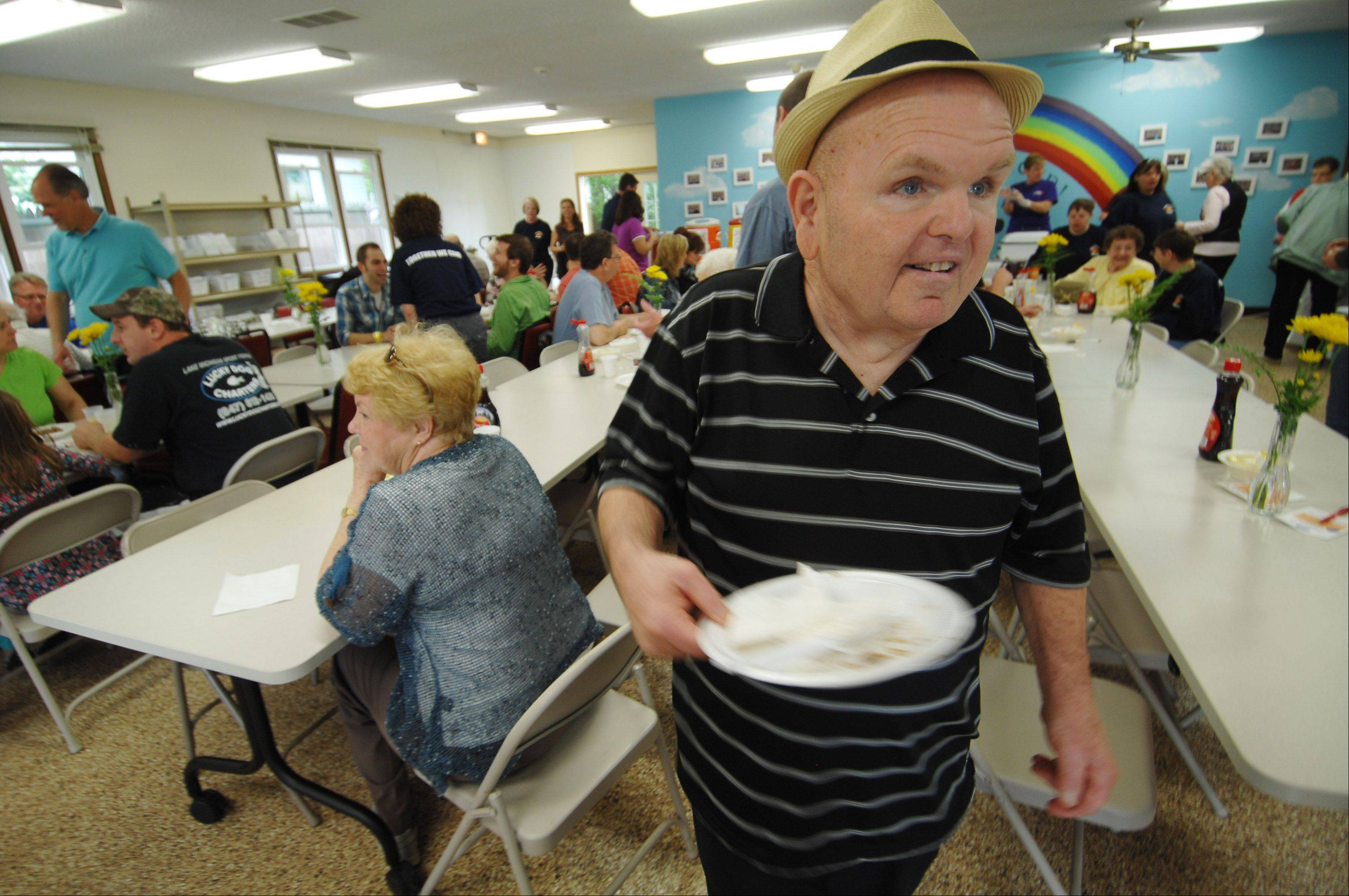 Trainee Joe Thompson clears tables at the Valley Sheltered Workshop 46th Annual Pancake Breakfast. It was the largest yearly fundraiser for the Batavia nonprofit facility where developmentally disabled adults work.