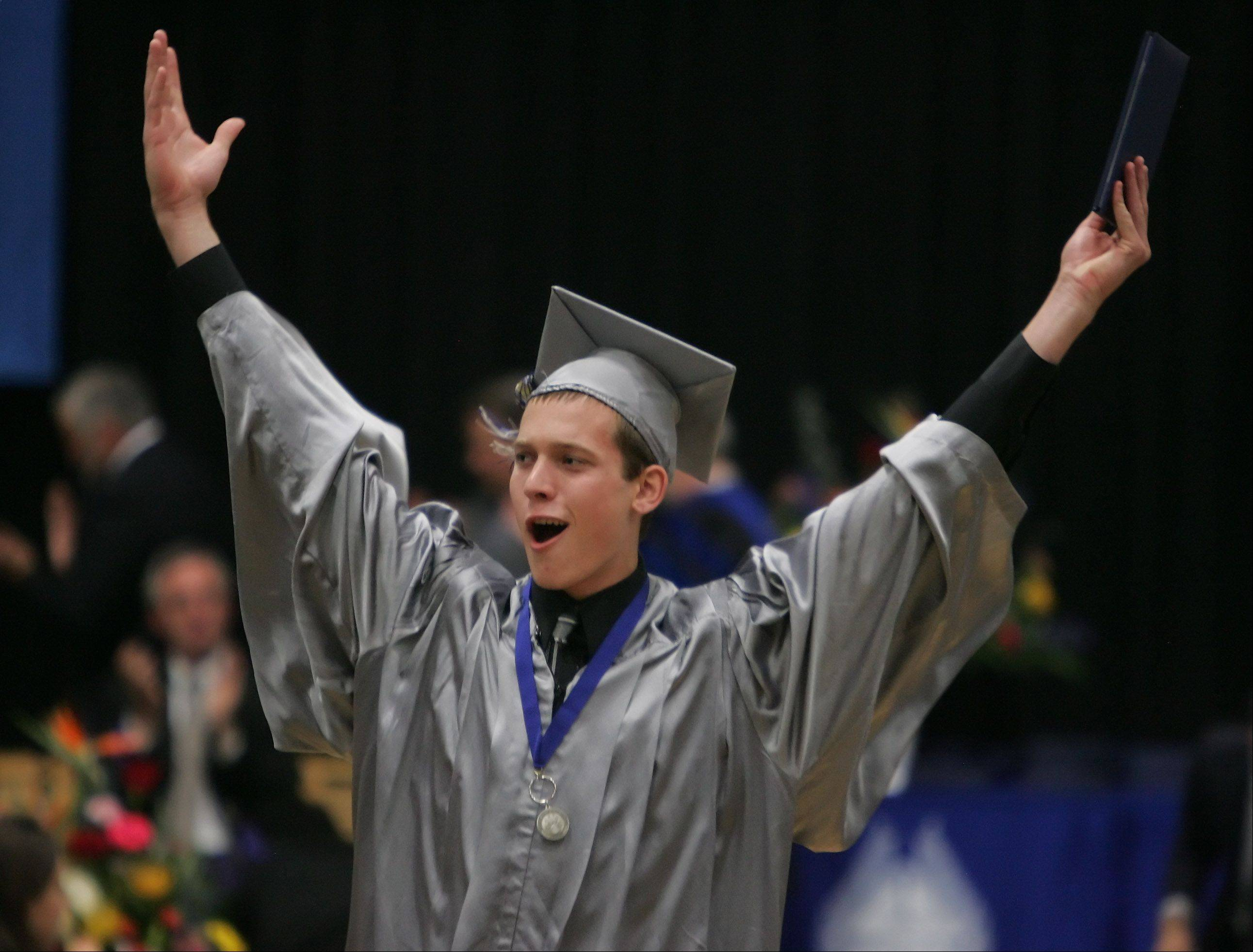 Brad Zwiener reacts after he was announced as the last to receive a diploma during the 11th commencement ceremony at Vernon Hills High School Thursday at the school.