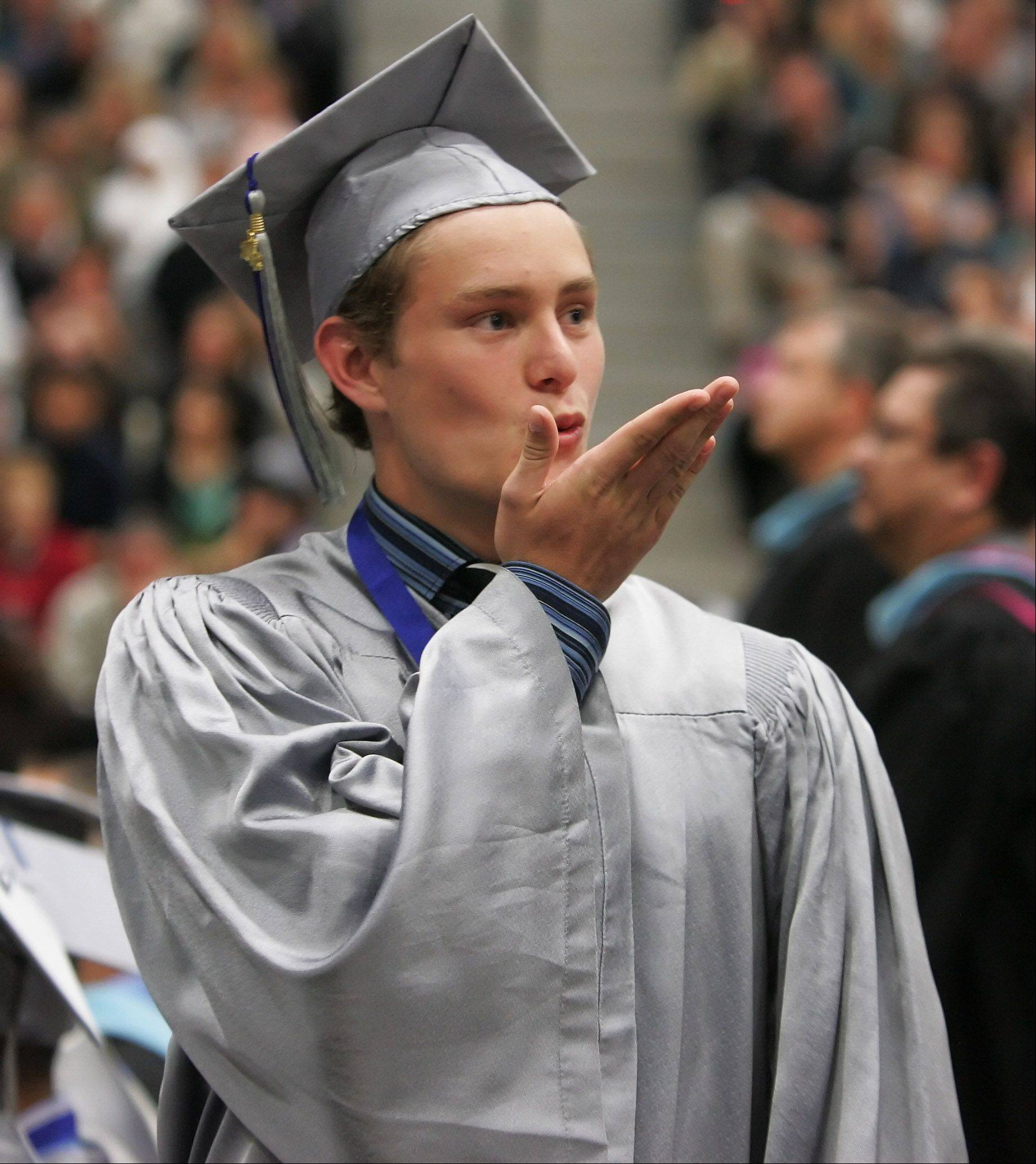 Dylan Gatz blows a kiss after receiving his diploma during the 11th commencement ceremony at Vernon Hills High School Thursday at the school.