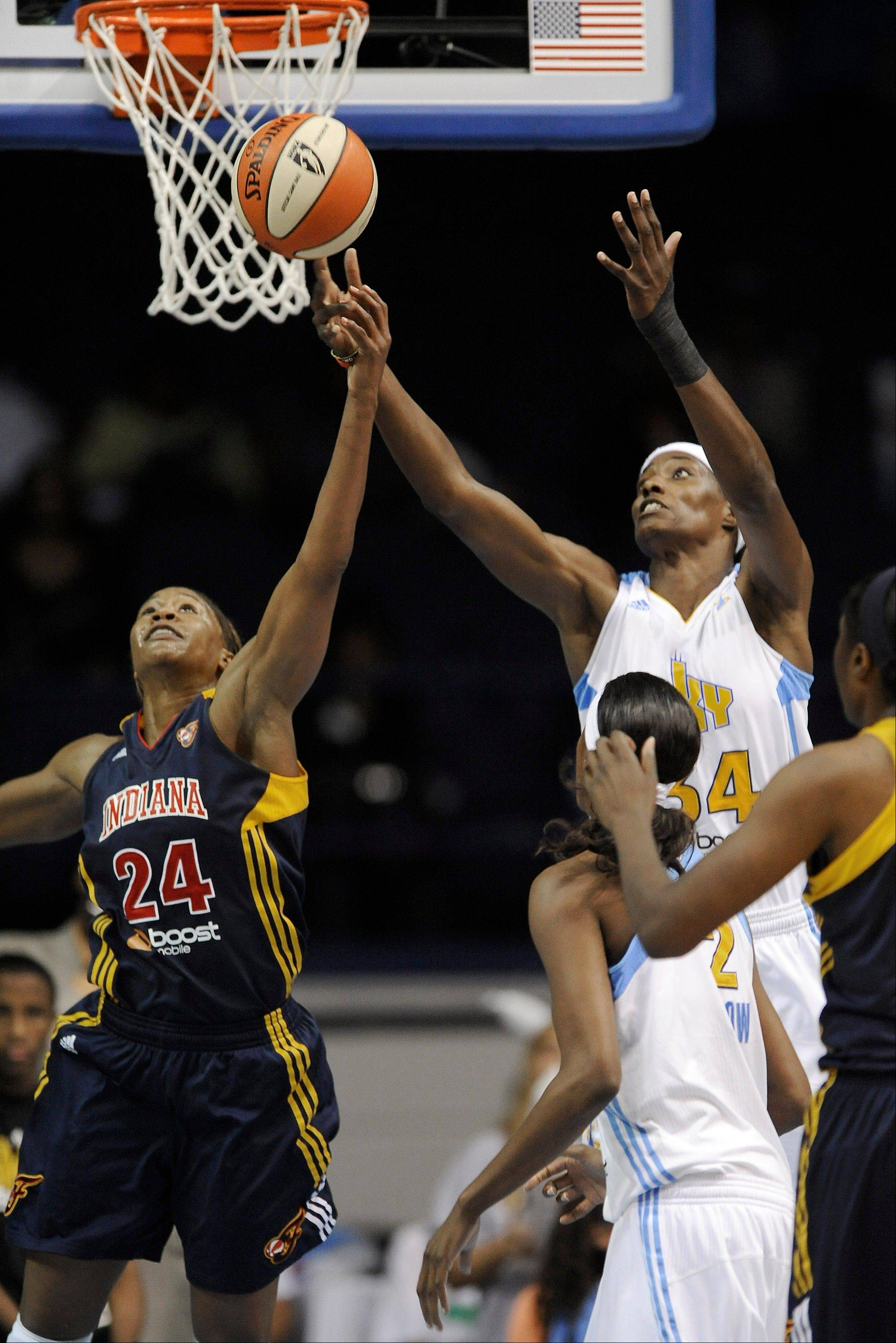 Tamika Catchings left, shown battling the Sky's Sylvia Fowles for a rebound in WNBA action last season, did not play overseas this winter in order to allow a foot injury to heal.
