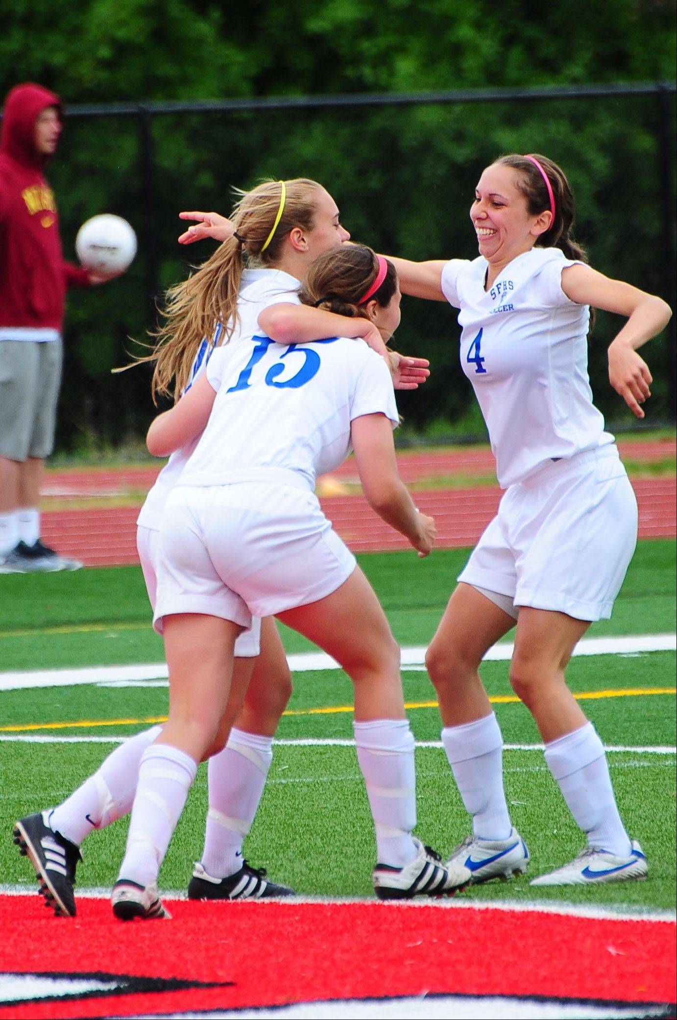 St. Francis' Amanda Gaggioli, Andrea Ravlin, and Sydney Fox celebrate after Gaggioli finds the net during their 1-0 victory over St. Viator on Friday.