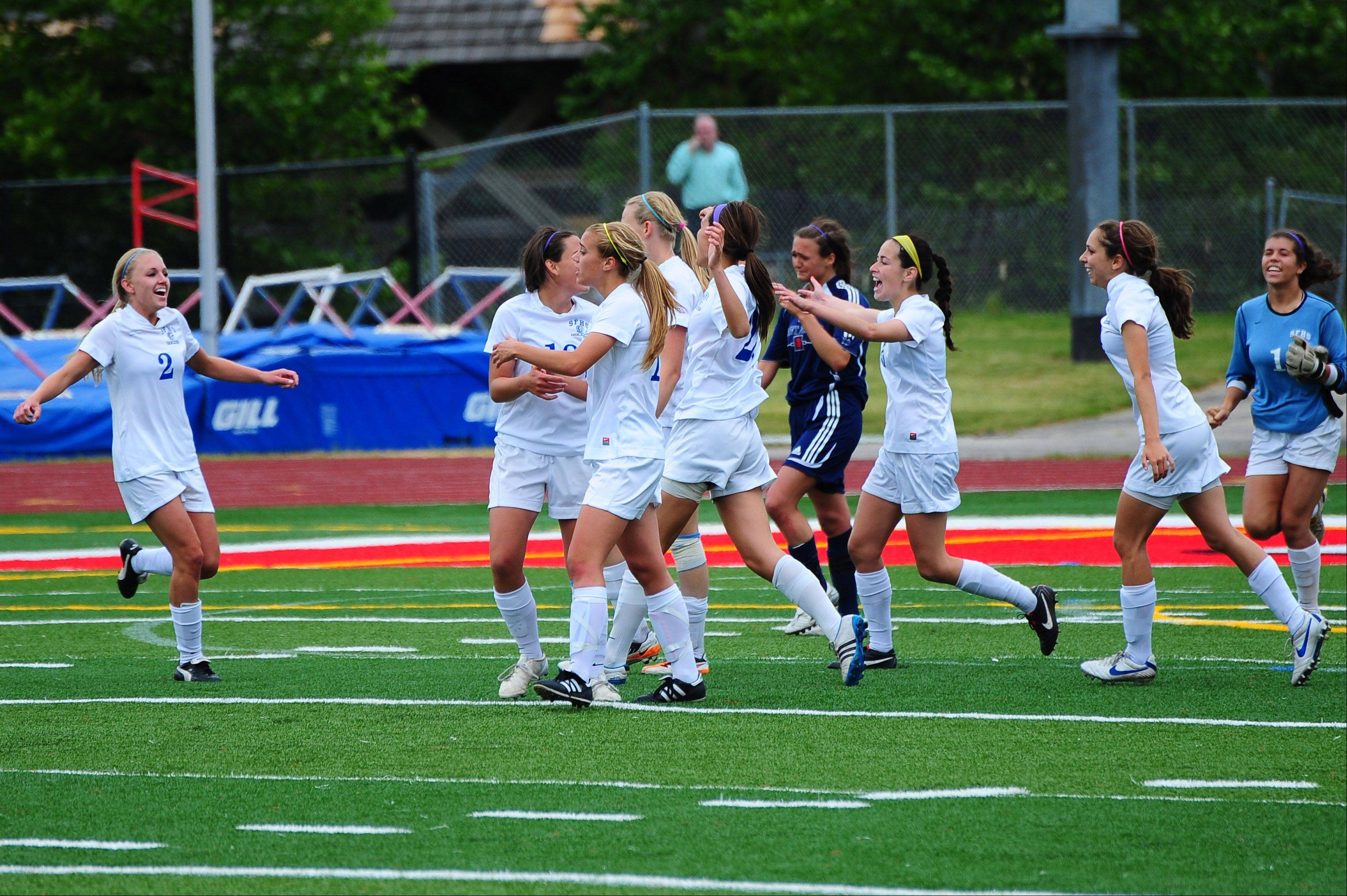 St. Francis teammates rush to celebrate their 1-0 victory over St. Viator during the girls soccer Class 2A semifinal on Friday.