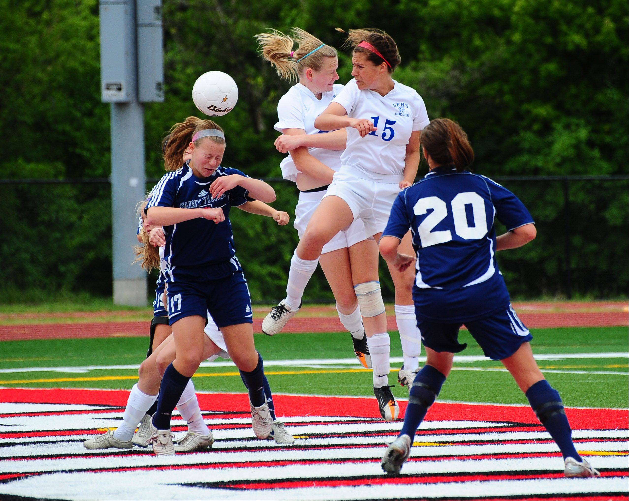 St. Francis' Andrea Ravlin attempts a header after receiving the ball off a corner kick during Friday's girls soccer Class 2A semifinal match between St. Francis and St. Viator.