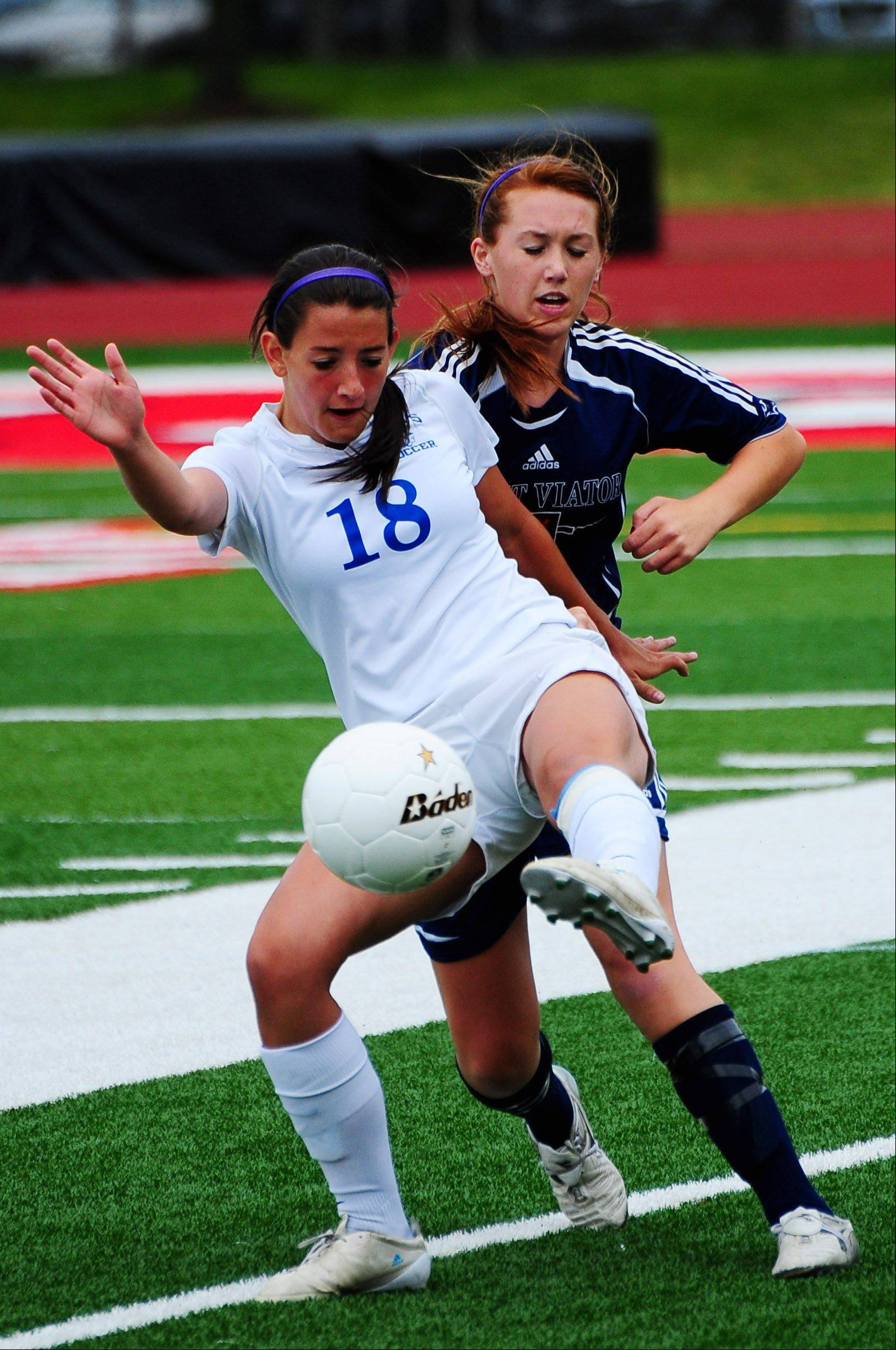 St. Francis forward Kaity Bucaro crosses the ball before a St. Viator defender can steal it away from her during the Class 2A girls soccer semifinal on Friday at North Central College.