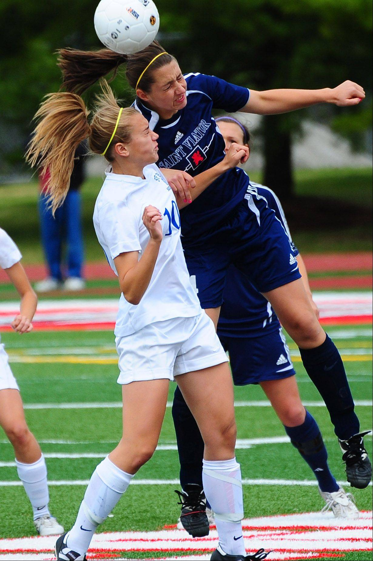 St. Francis midfielder Amanda Gaggioli battles St. Viator's Lauren Falotico for a head ball during the Class 2A girls soccer semifinal on Friday at North Central College.