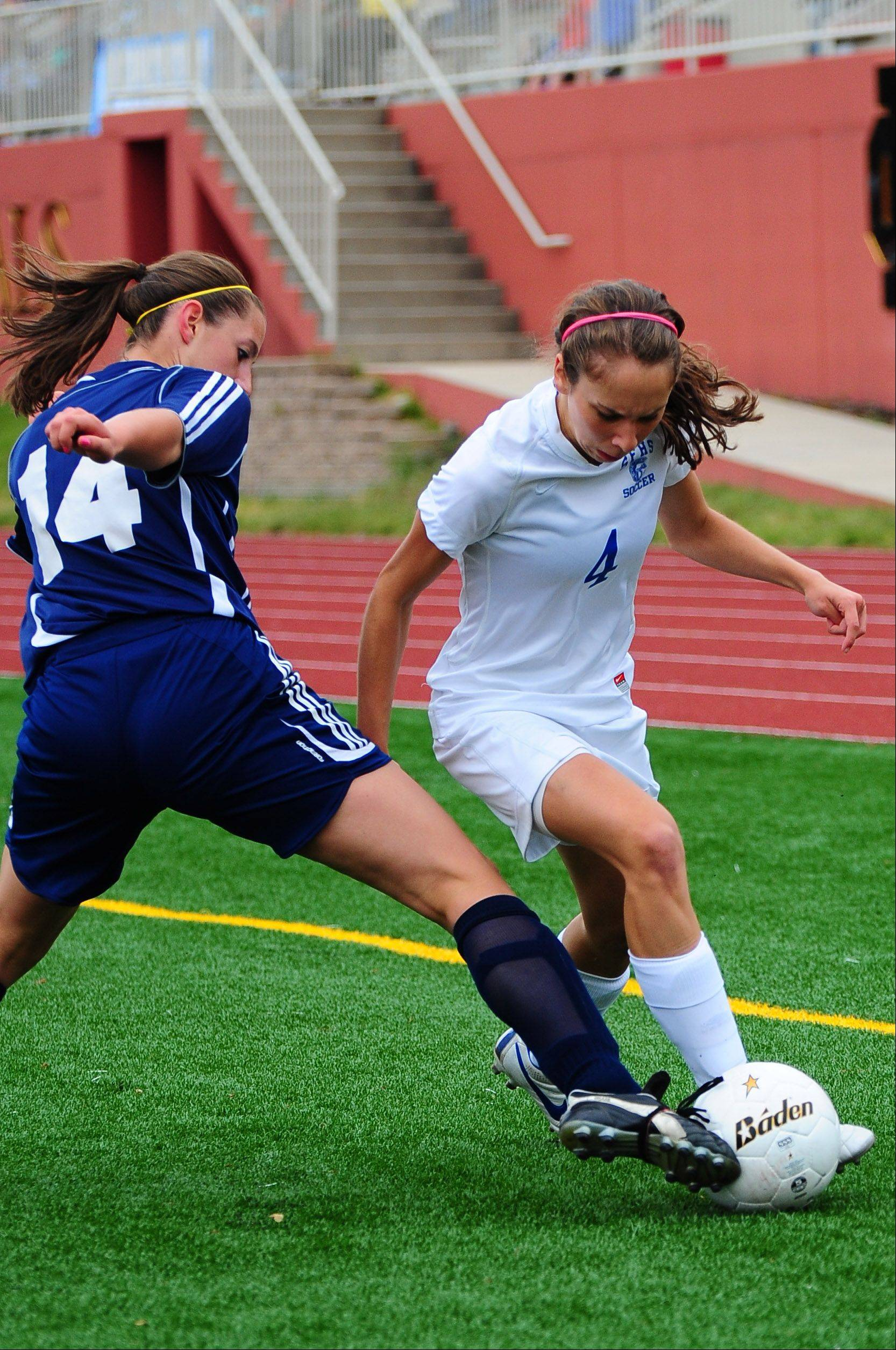 Syndey Fox, of St. Francis, tries to dribble past St Viator midfielder Lauren falotico during the girls soccer Class 2A semifinal on Friday.