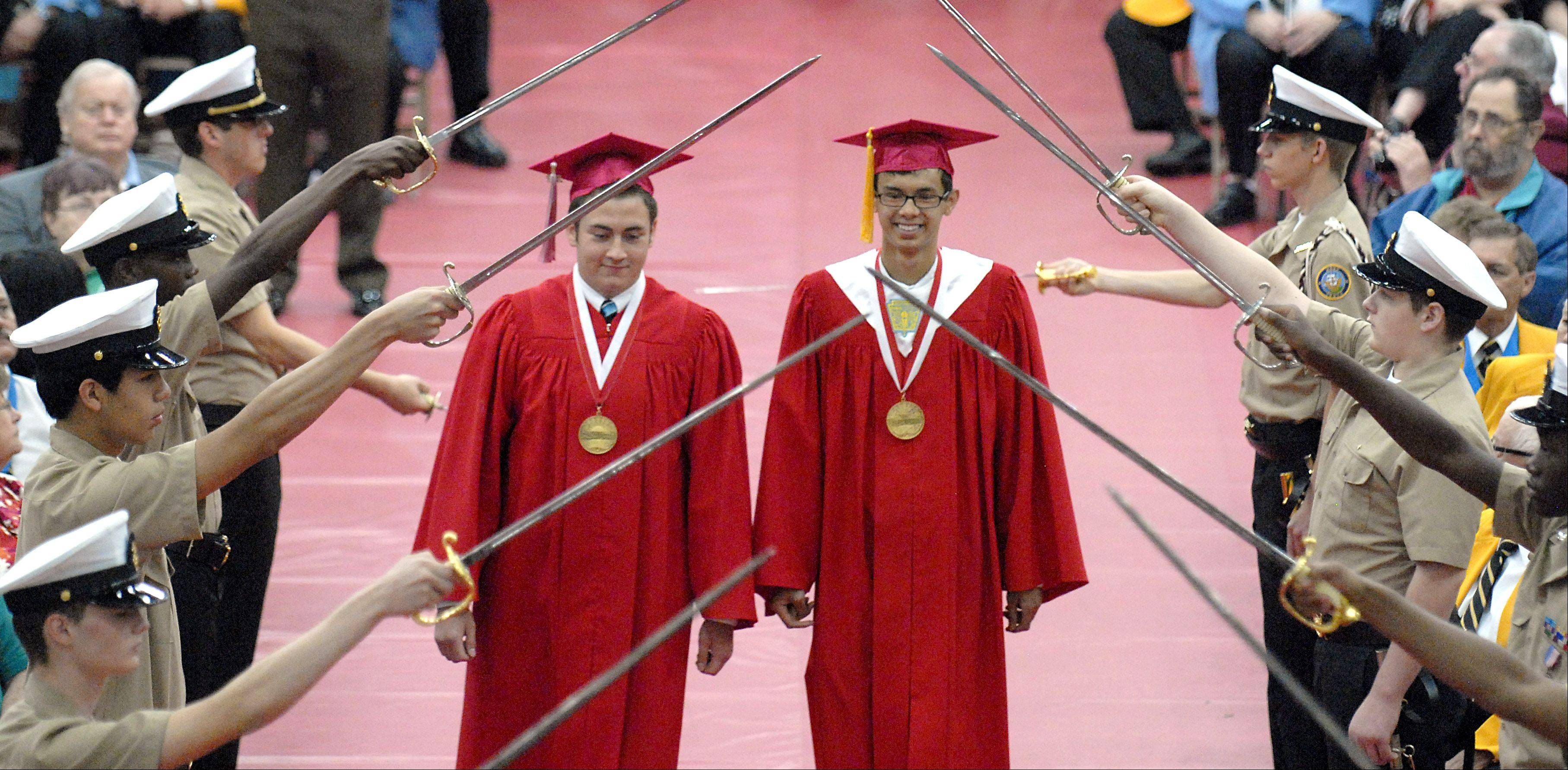 Salutatorian Mason Rueger of Bloomington, left, and valedictorian James Ranum of Campbell, CA are the first grads to walk to the stage for their graduation from Mooseheart High School in Batavia on Saturday, June 2. The class of 2012 had 16 graduates.