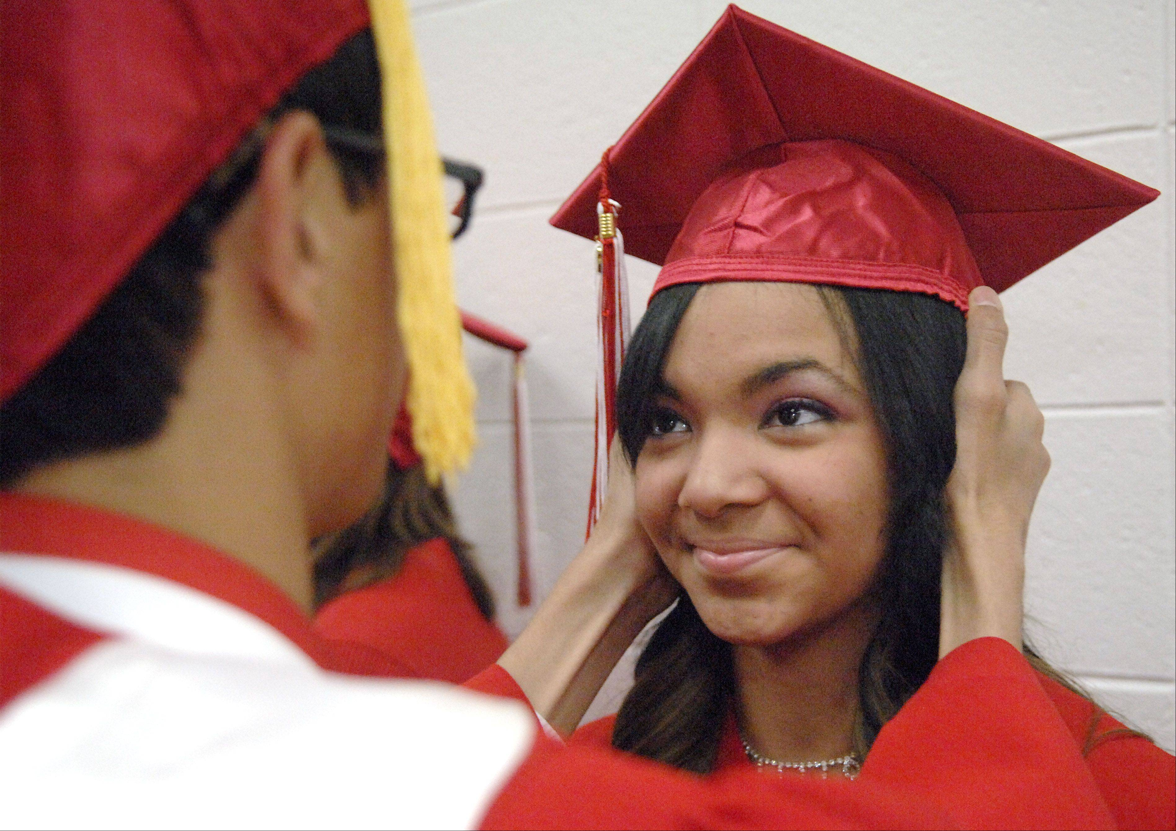 Yolanda Linneman of Chicago Heights has her cap adjusted by friend and classmate James Ranum of Campbell, CA before they walk into the gymnasium for their graduation ceremony from Mooseheart High School in Batavia on Saturday, June 2. Ranum was the class valedictorian.