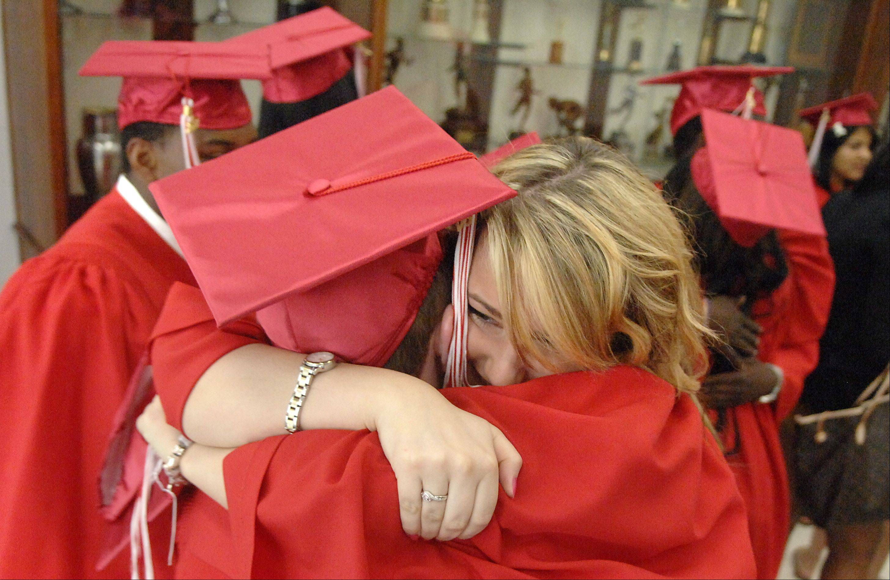 Hannah Avery hugs Zachary Rice before they and fellow classmates of Mooseheart High School line up for their graduation in Batavia on Saturday, June 2. The class of 2012 had 16 graduates. Avery is from Poole, England and Rice is from Inverness, FL.