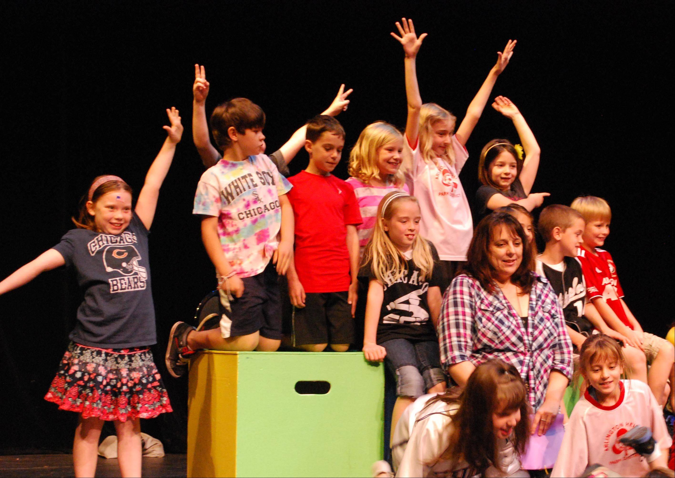 Following the performances, Dryden second-grade writers gathered onstage to celebrate seeing their work come alive.