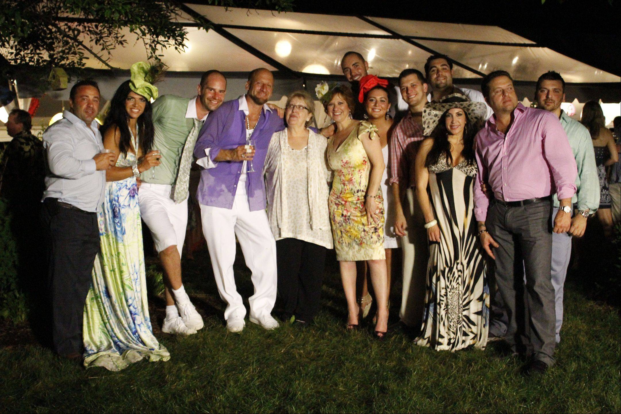 "Rich Lane and Jaime Laurita pose with the cast of ""The Real Housewives of New Jersey"" during the reception at their civil union ceremony, which will be featured on the next two episodes of the Bravo TV show."
