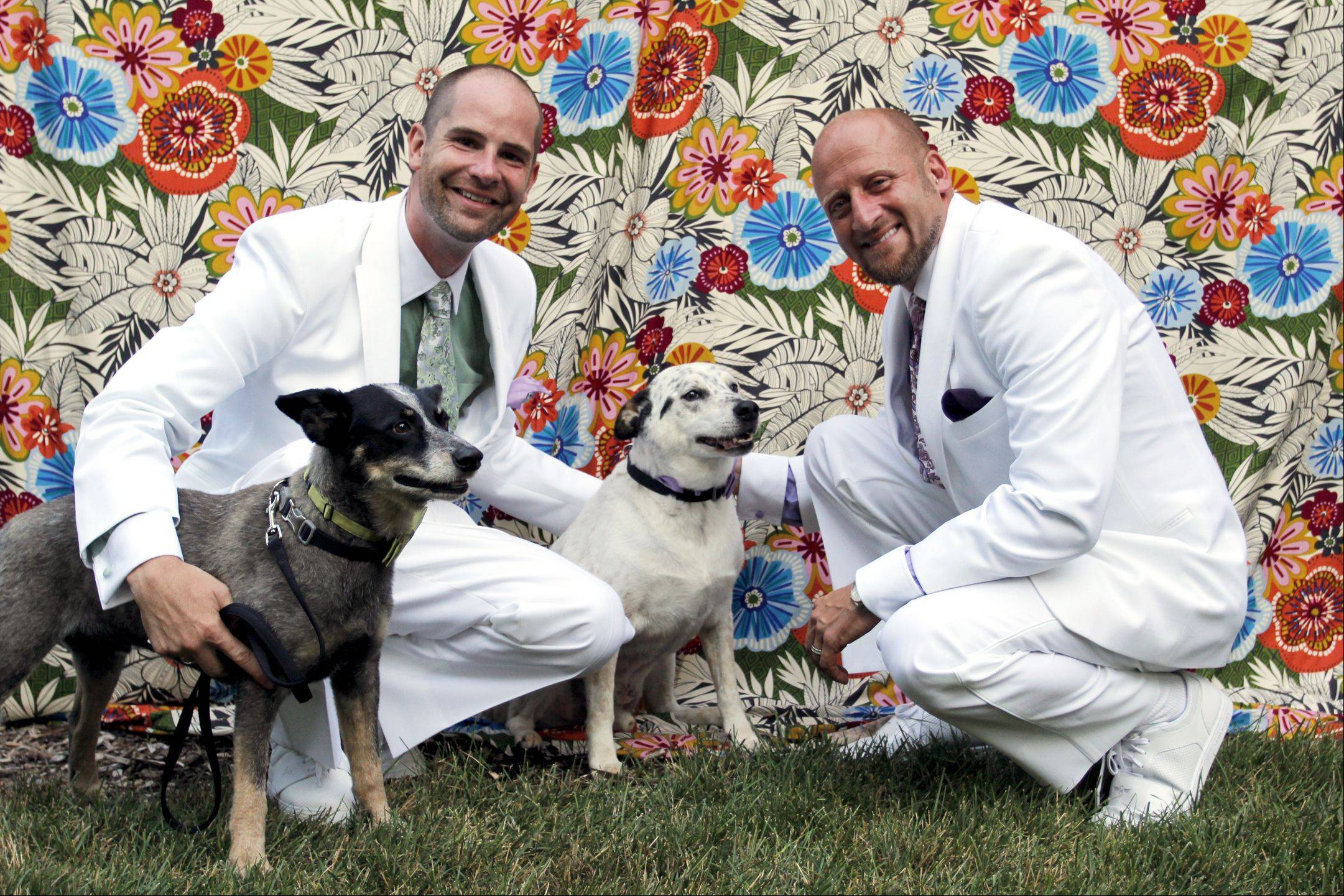 Rich Lane, left, and Jaime Laurita with their best men, Chip (white dog) and Bean (gray dog).