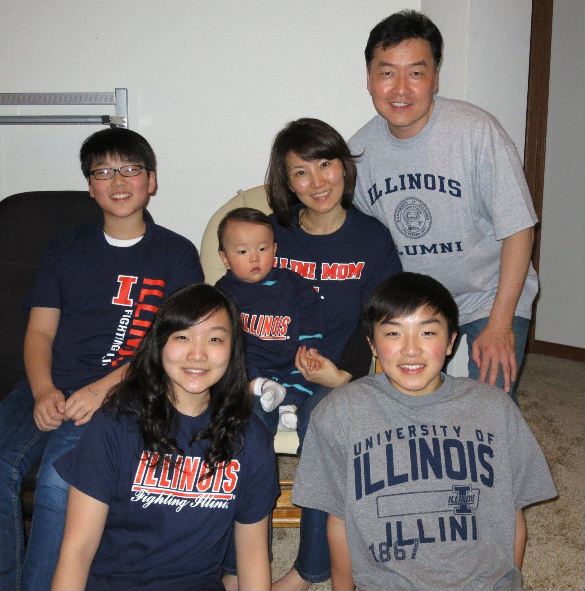 South Middle School Principal Jeannie Sung with her husband, Jim Sung, and their children, from left, Jonathan, Jessica, Daniel and Paul. She is leaving the school to move to Guangzhou, China.