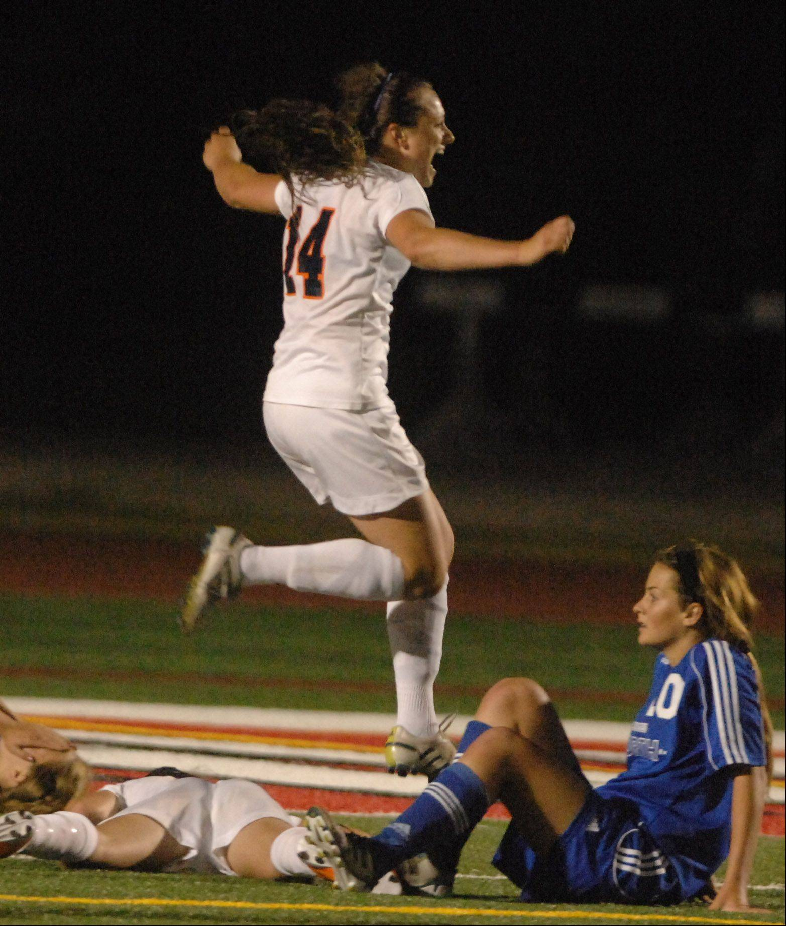 Christa Szalach of Naperville North jumps into the air after scoring the winning goal during the class 3A girls championship game at North Central College.