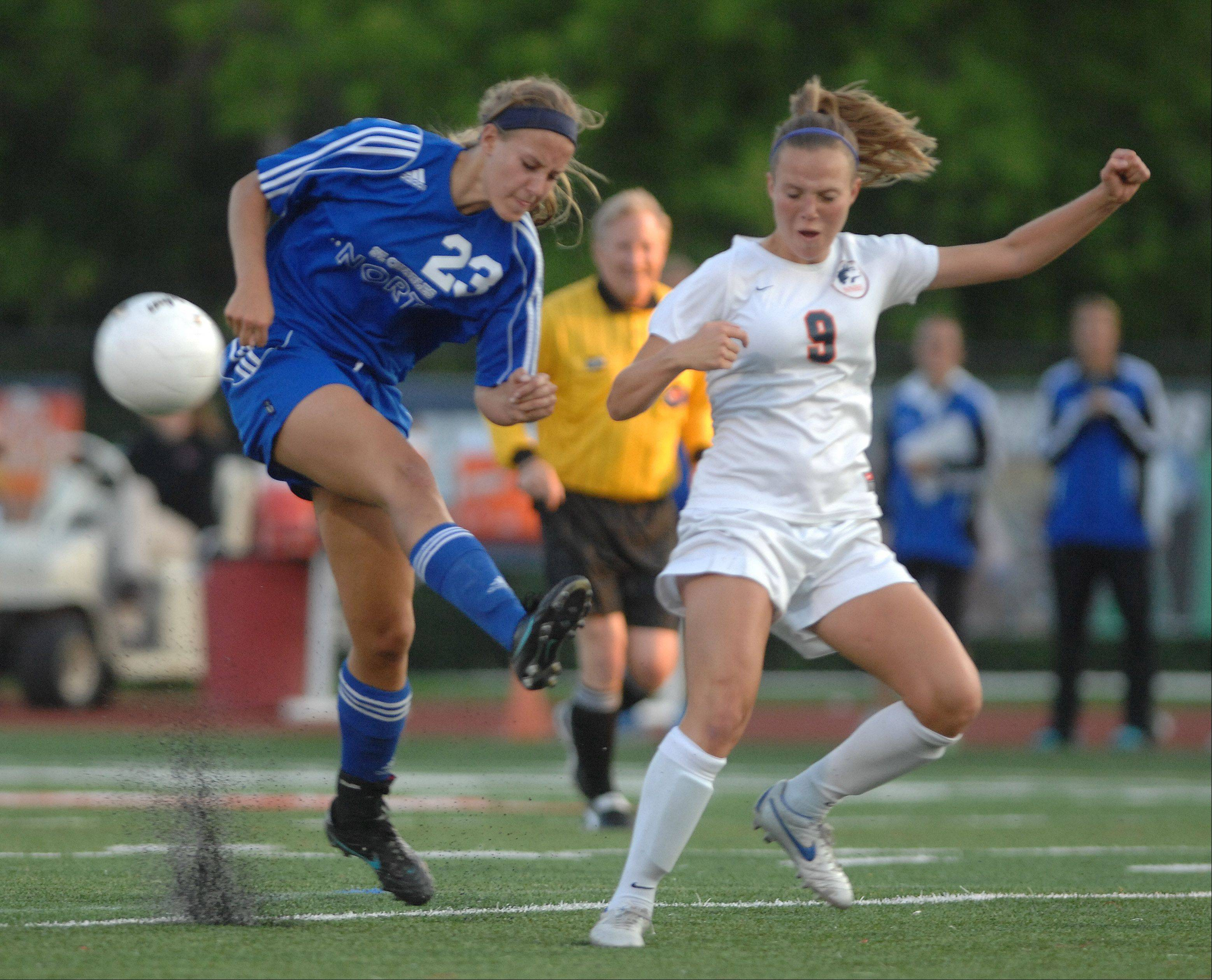 Lauren Koehl of St. Charls North and Jen Korn of Naperville North fight for the ball during the Class 3A girls championship game at North Central College.