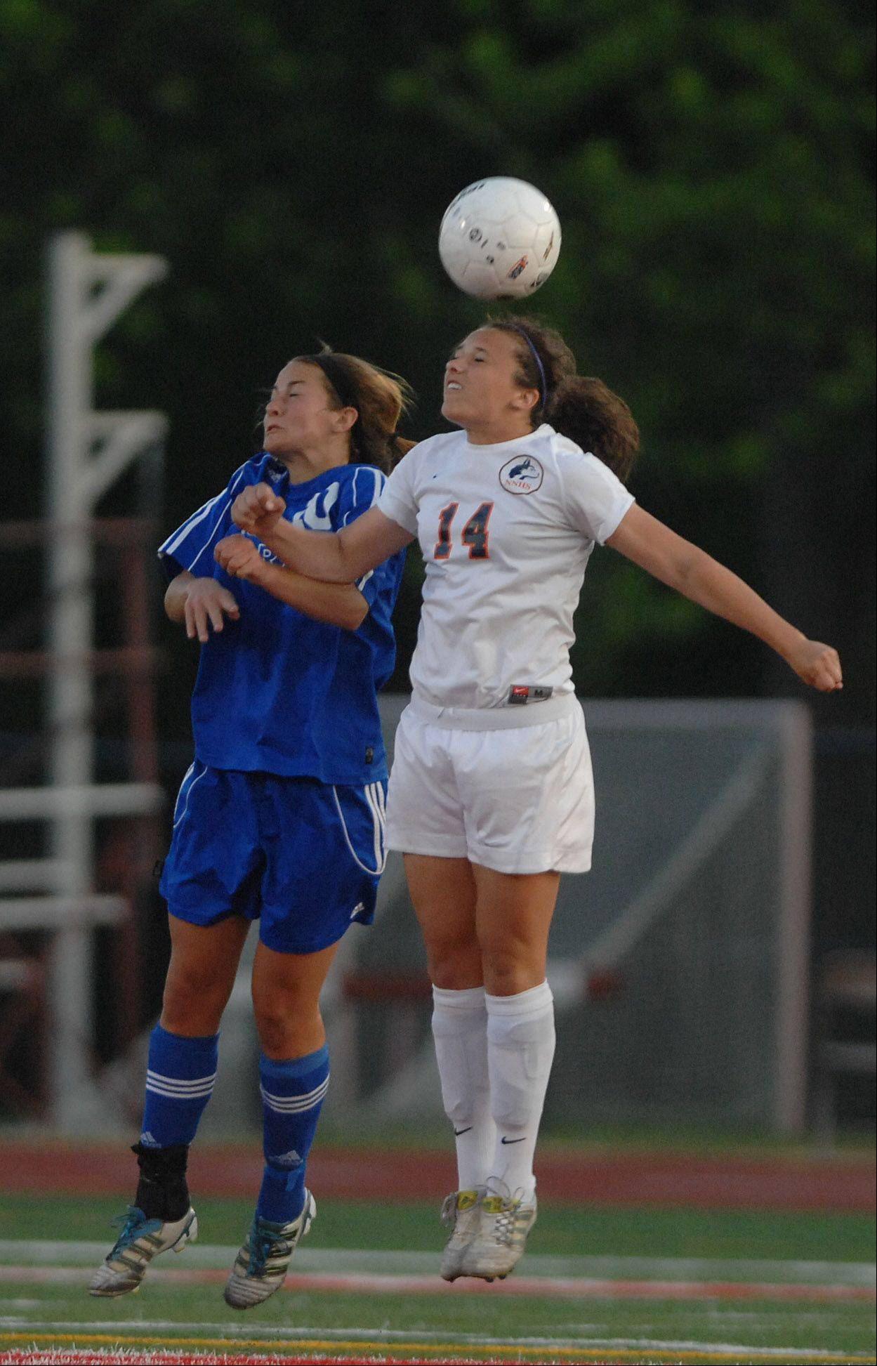 Jorie Clawson of St. Charles and Christa Szalach of Naperville North go up for a header during the class 3A girls championship game at North Central College.