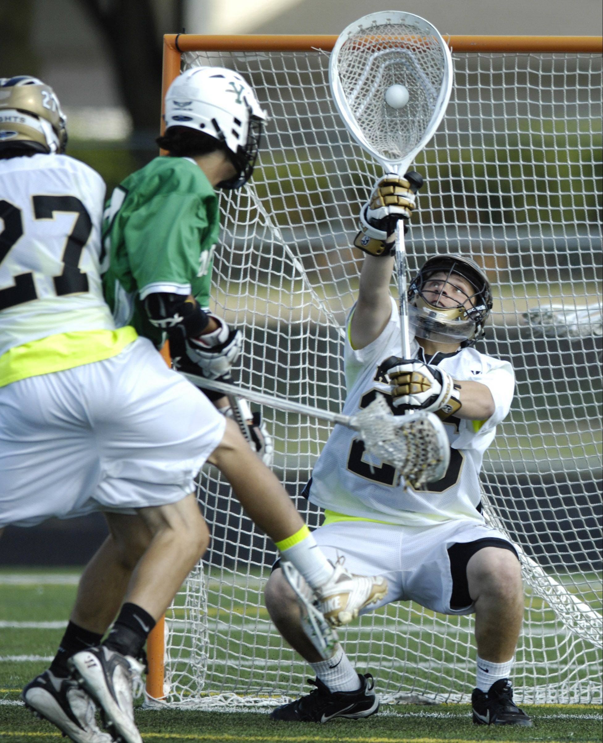 Grayslake North goalie Eric York reches up to make a save during the Lacrosse Cup championship game against York at Palatine High School on Saturday.