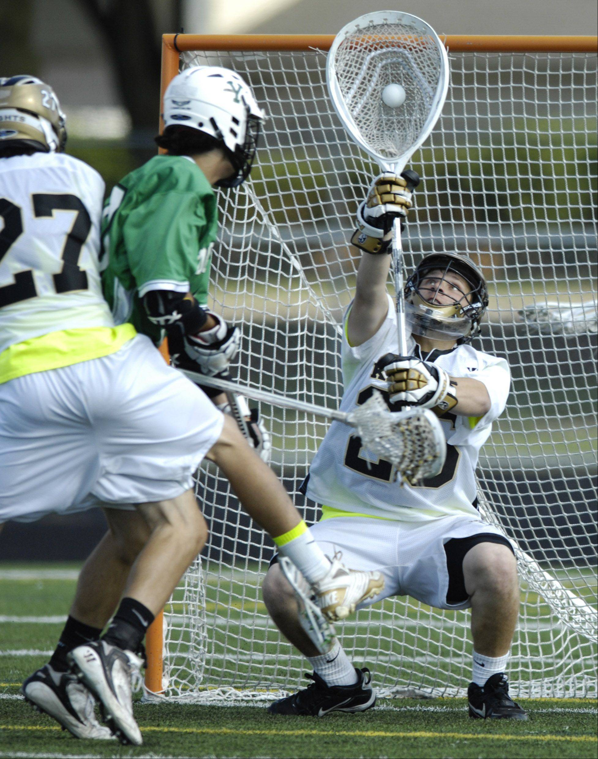 Grayslake North goalie Eric York reaches up to make a save during The Lacrosse Cup championship game against the York Dukes at Palatine High School Saturday.