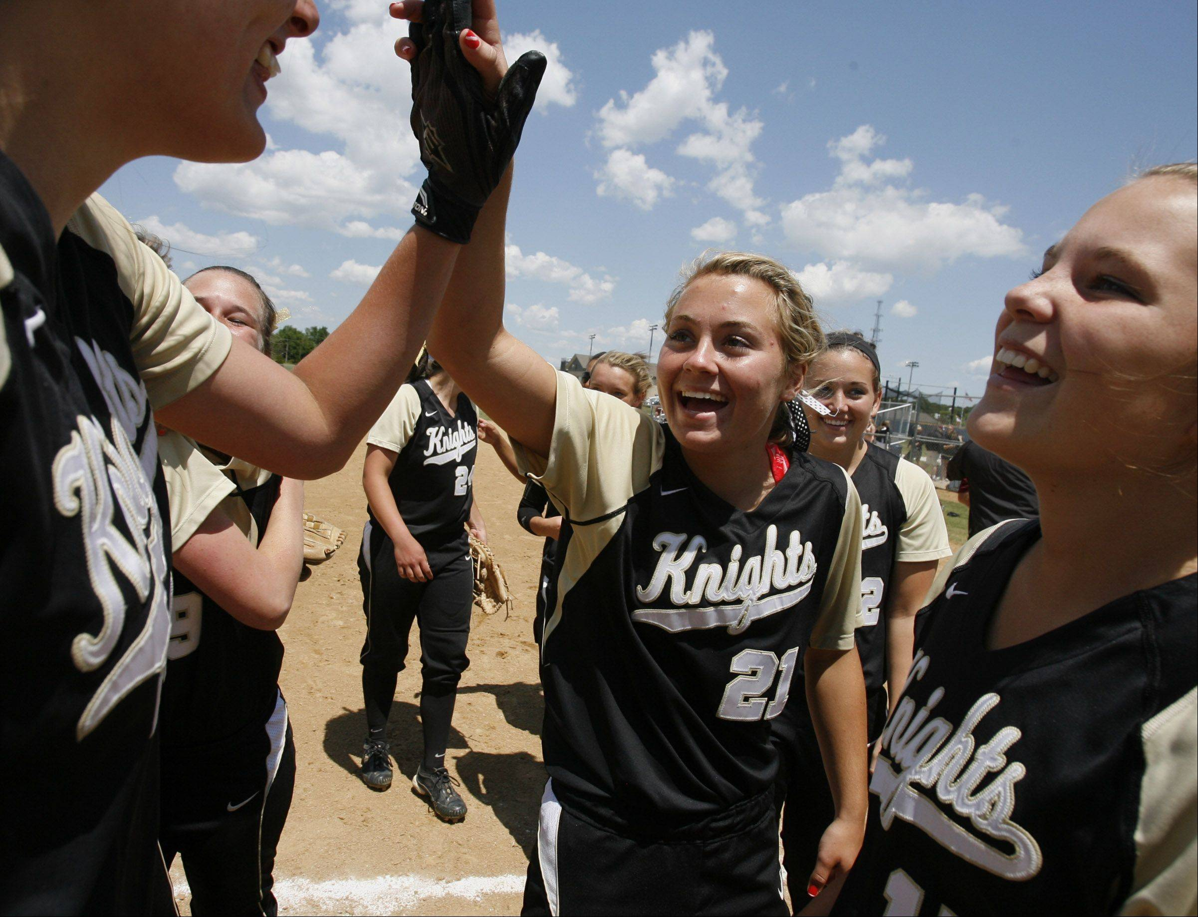 Grayslake North's Mariah Gentile gets a high-give after winning the Class 3A Lakes softball sectional final against Prairie Ridge in Lake Villa on Saturday.