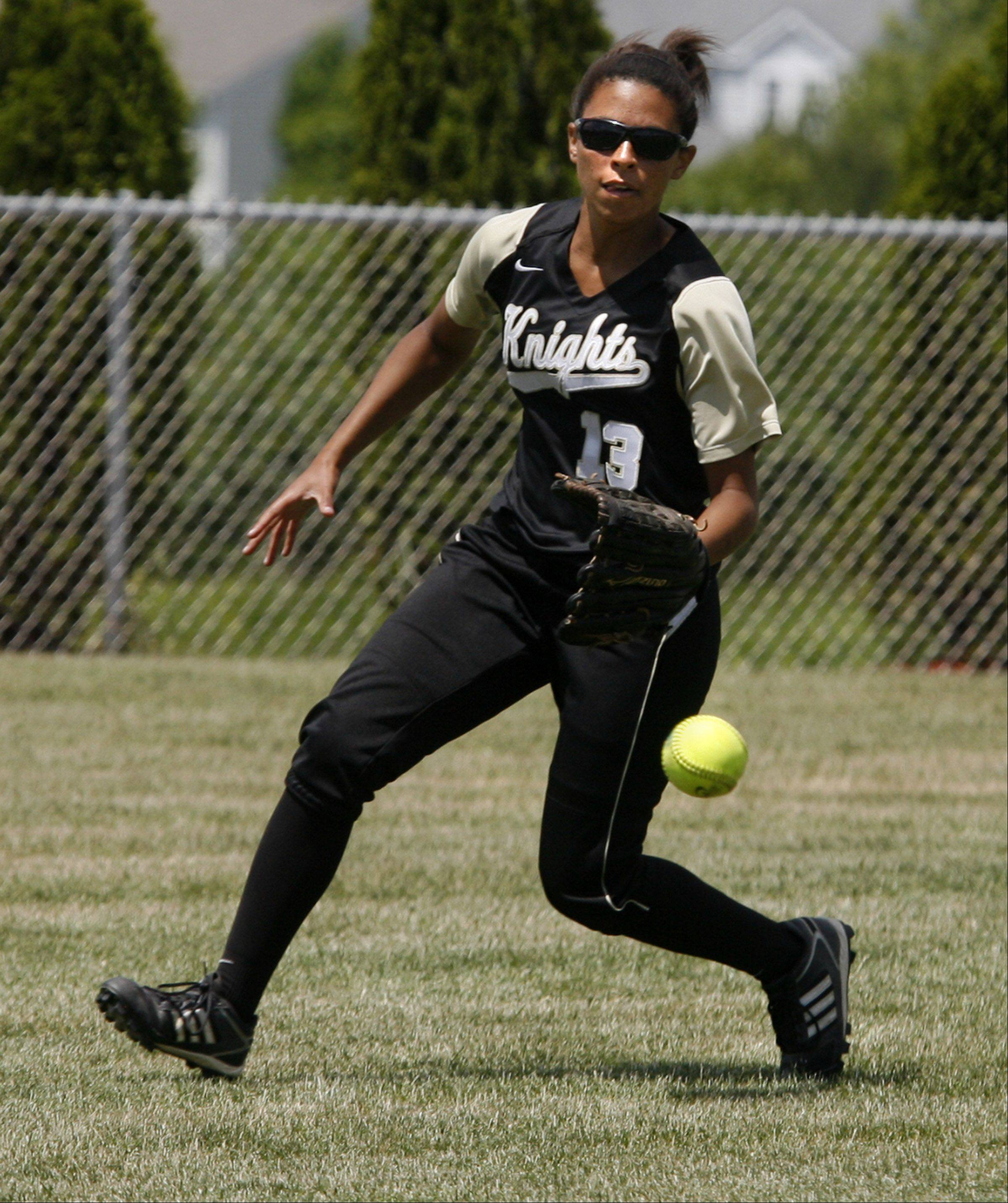 Grayslake North Courtney Peterson fields an outfield hit by Prairie Ridge in Class 3A Lakes softball sectional final action in Lake Villa on Saturday.