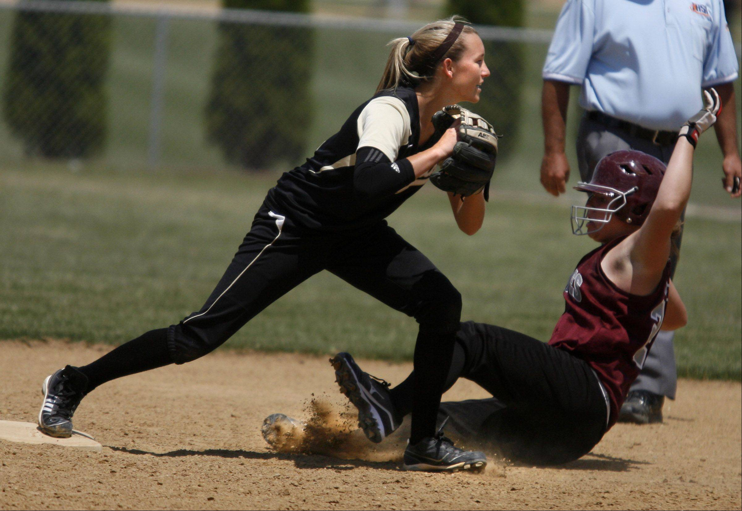 Grayslake North's Jordyn Bowen looks to first for the double play as Prairie Ridge's Kate Dider is out at second in the Class 3A Lakes softball sectional final play in Lake Villa on Saturday.