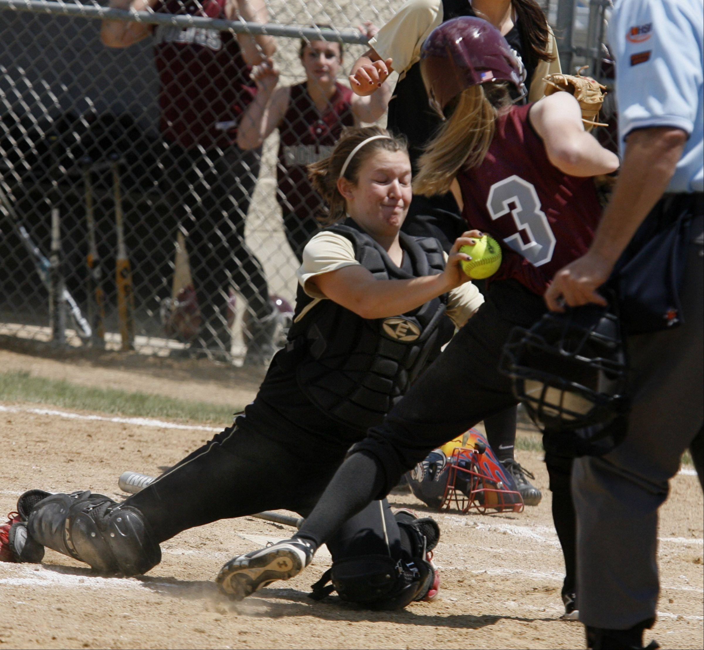 Grayslake North catcher Brooke Tracy tags Prairie Ridge's Erin Wing out at the plate in the Class 3A Lakes softball sectional final in Lake Villa on Saturday.
