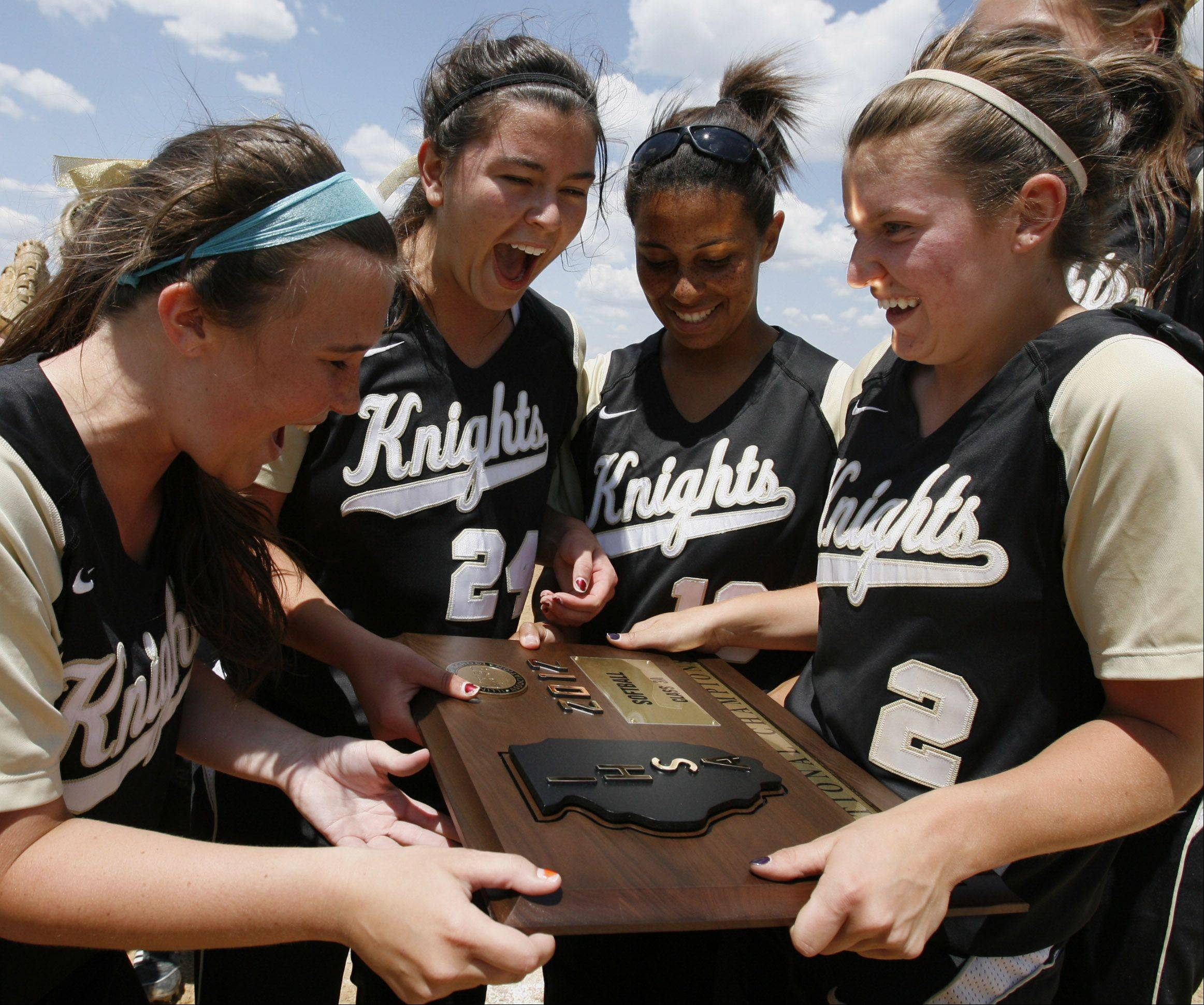 Grayslake North softball team including pitcher Kristina Gandy, second from left, and catcher Brooke Tracy, far right, celebrate winning Class 3A Lakes softball sectional final against Prairie Ridge in Lake Villa on Saturday.