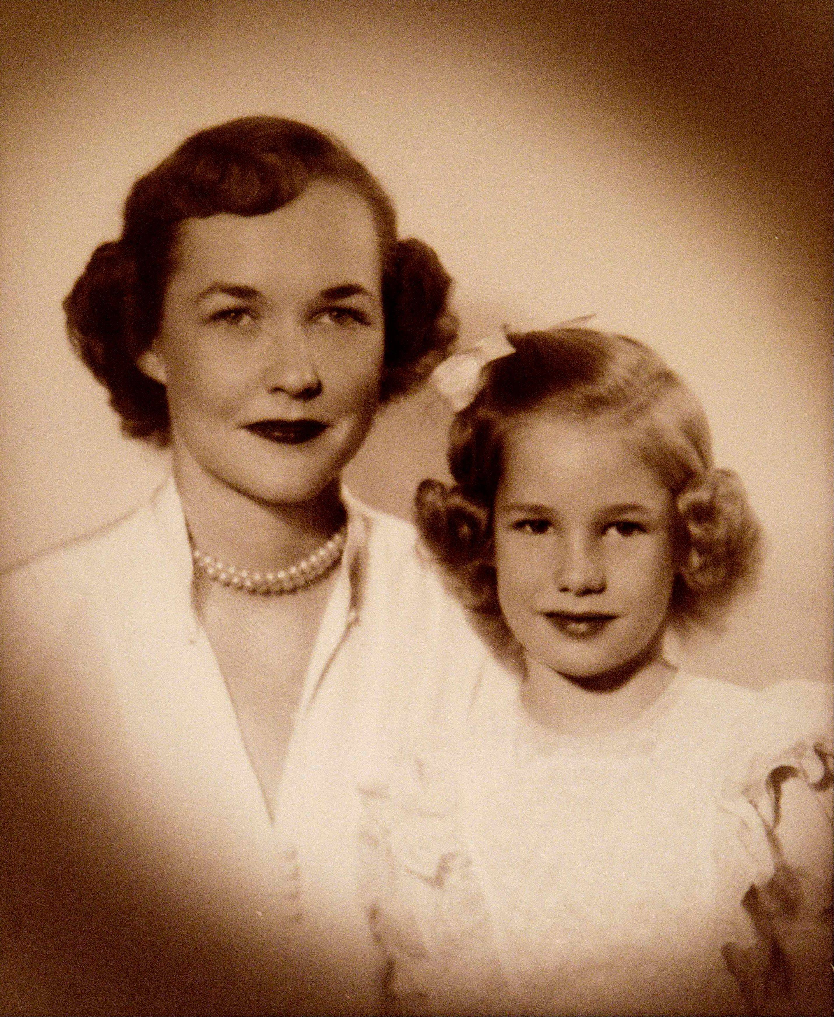 This undated photo provided by Penny Hart shows Hart as a young girl, right, and her mother, Henrietta Collier Armstrong Ayer who died fifty years ago in a plane crash, is seen in Hart's home Friday, May 4, 2012, in Atlanta. Hart was a 19-year-old college sophomore studying at the Sorbonne when her mother was aboard the returning chartered Air France plane carrying a group of Atlanta's cultural leaders that crashed on takeoff at Orly Field in Paris.