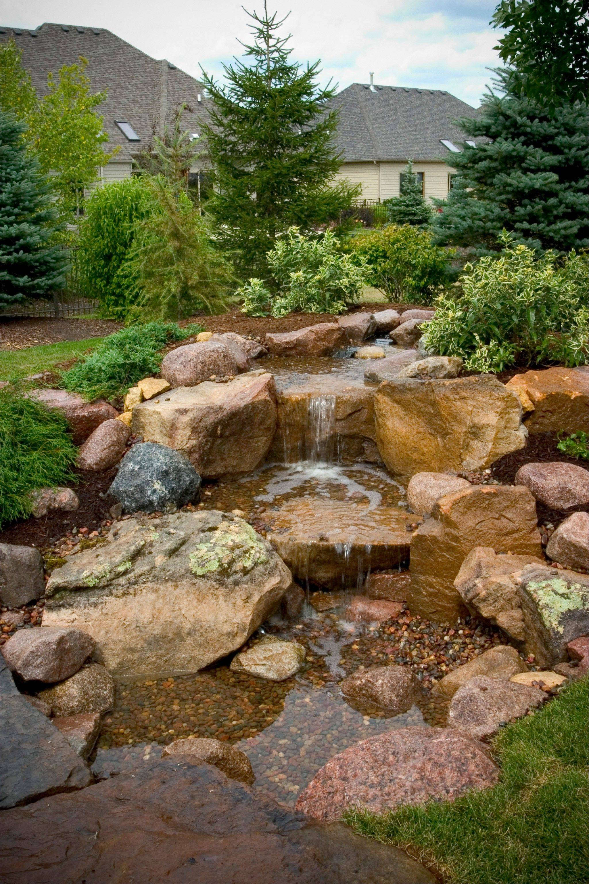 A waterfall with moss rock boulders will bring any landscape to life.