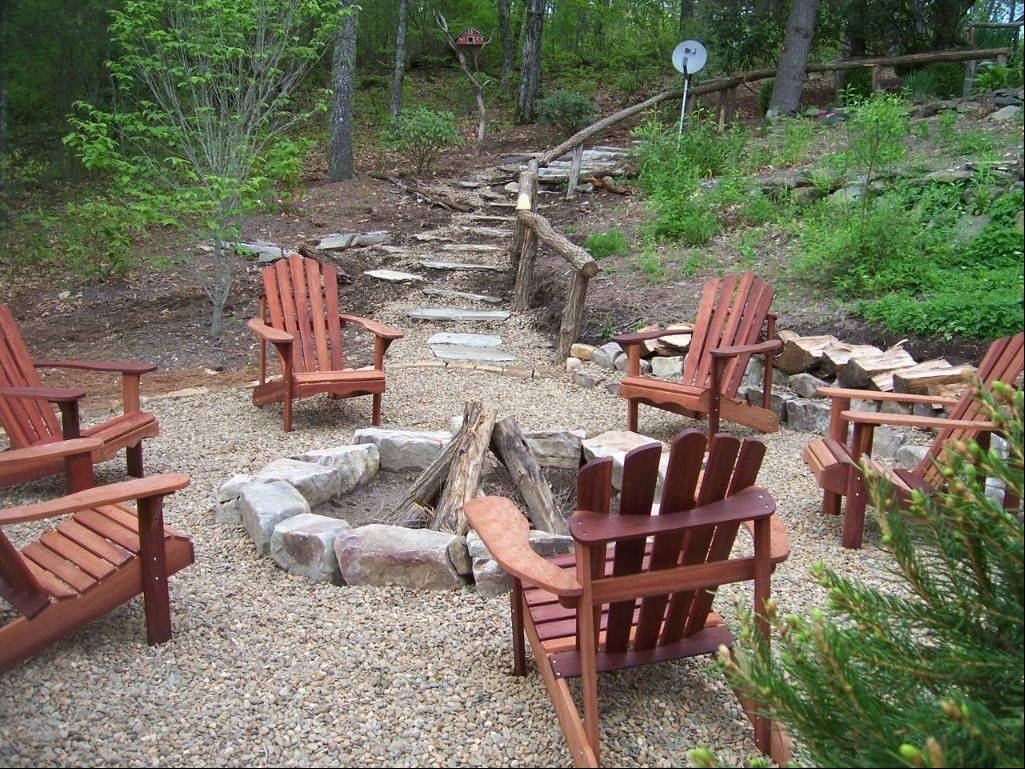 A fire pit combined with a discovery area including a path and boulders will make the back of the yard a destination for visitors.