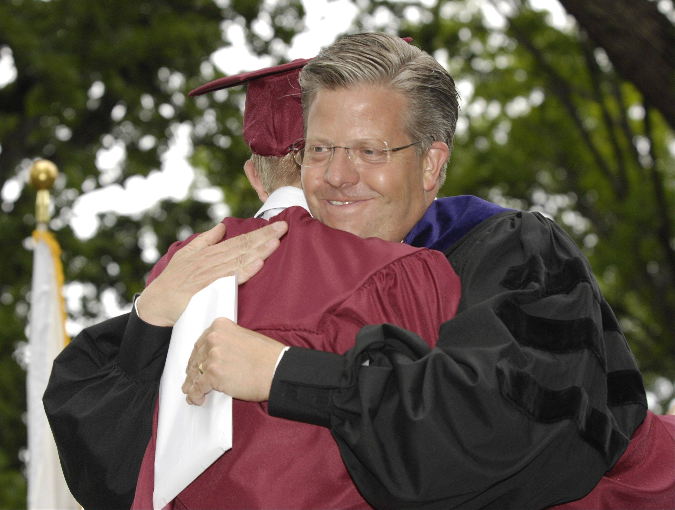 U.S. Congressman Randy Hultgren was able to present his son Karsten with his diploma after giving the keynote address at the Wheaton Academy graduation, Sunday.