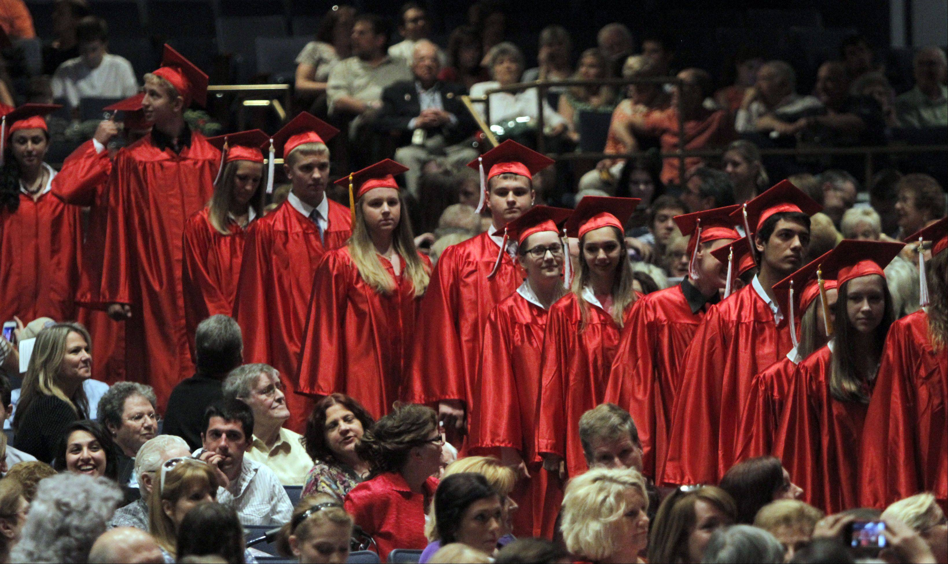 Maine South High School seniors head to the stage during their graduation ceremony at Rosemont Theatre on Sunday.